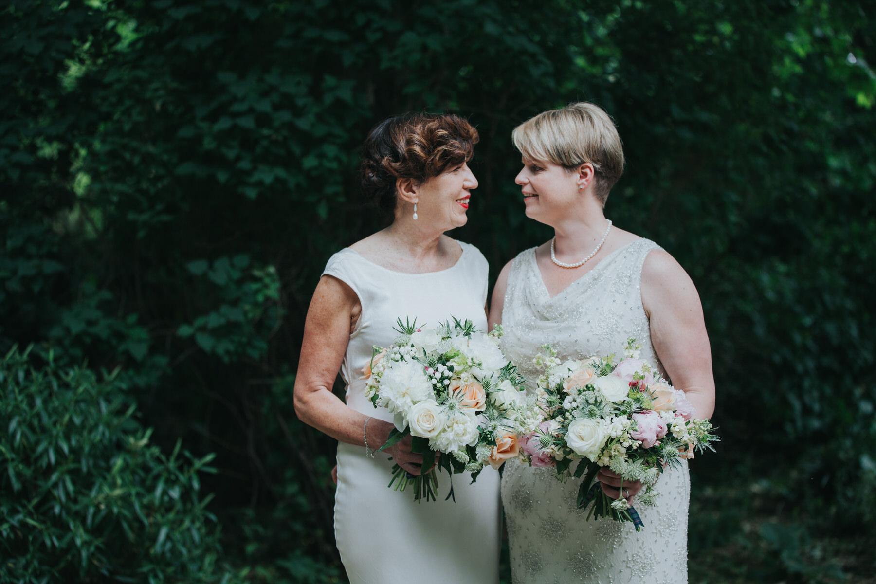 160 two brides couple portraits London park.jpg
