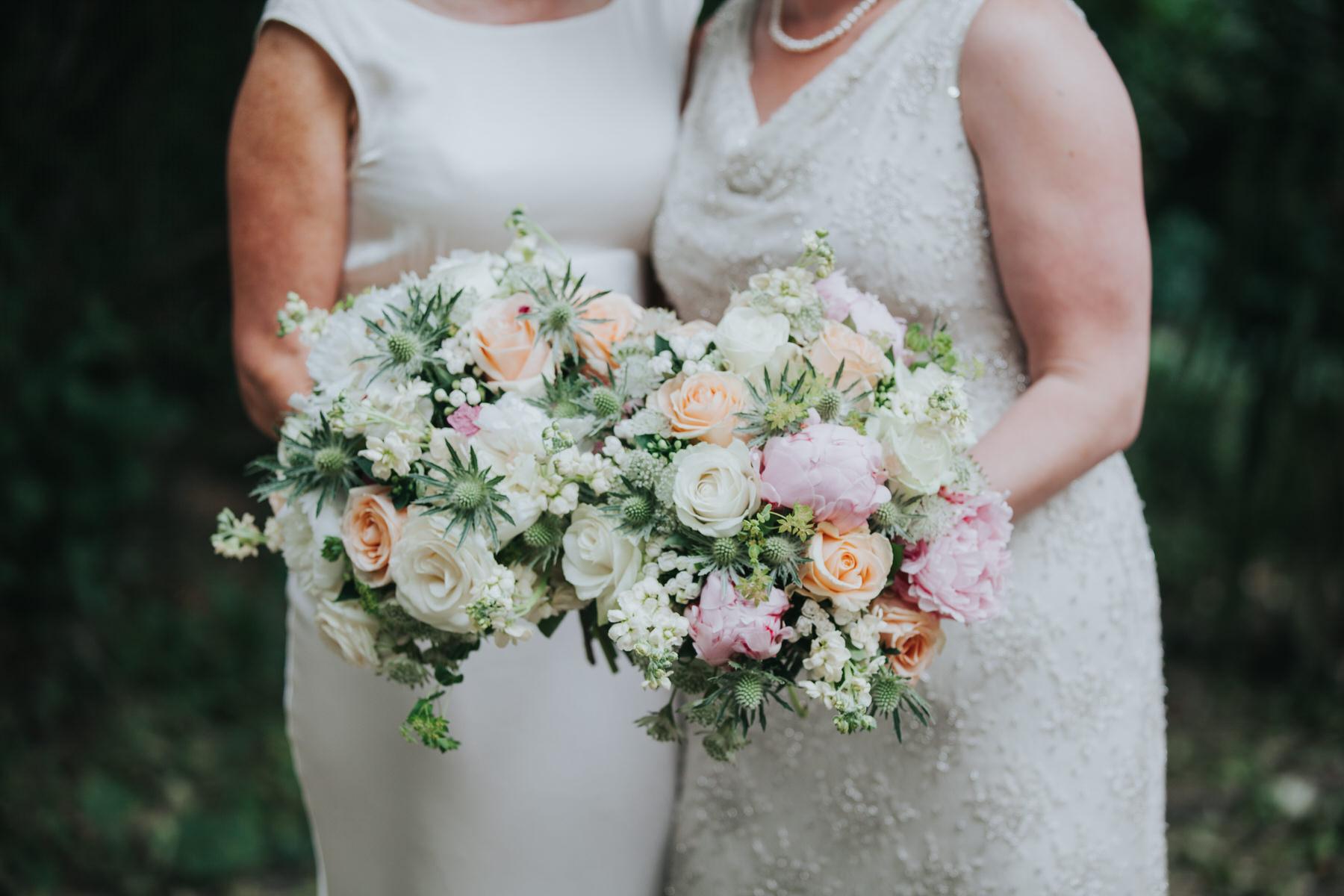 166 double blush bouquet photo two brides.jpg