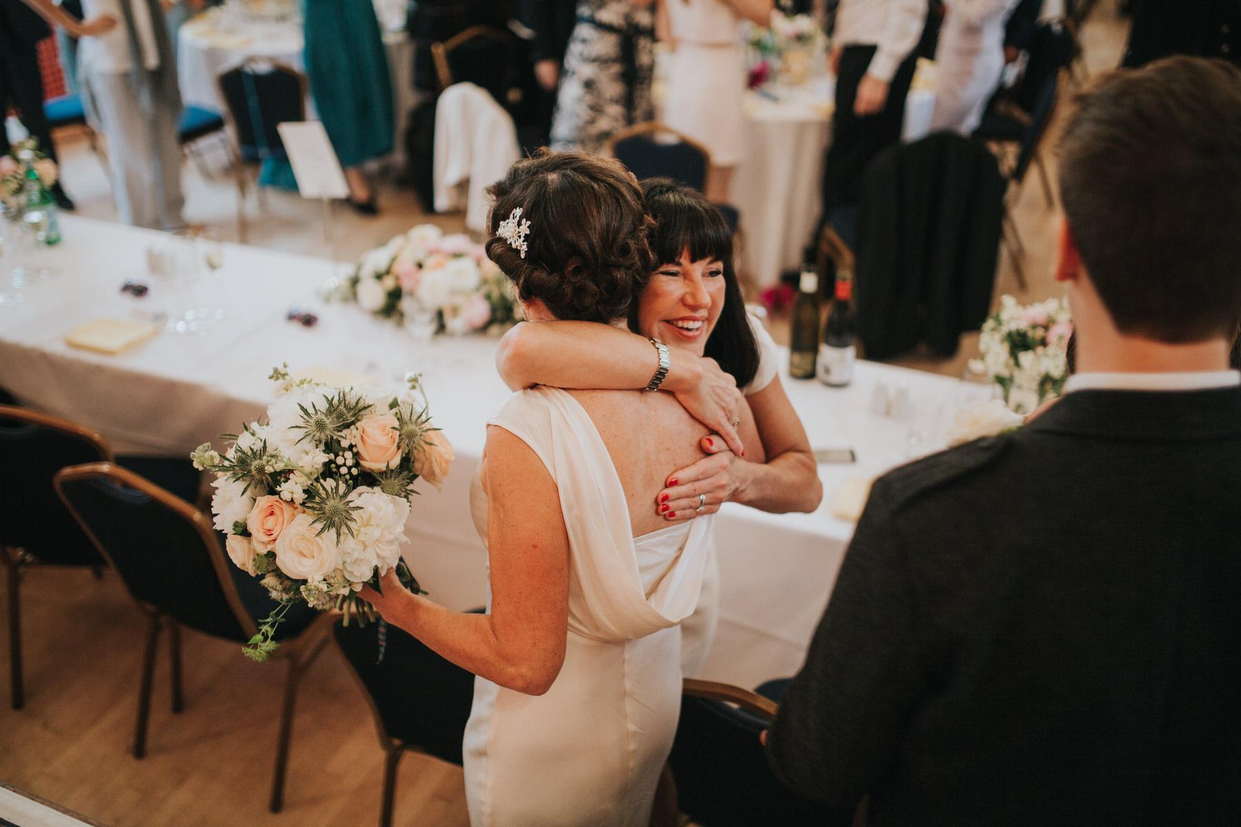 220 bride hugged by sister Old Finsbury Town Hall wedding.jpg