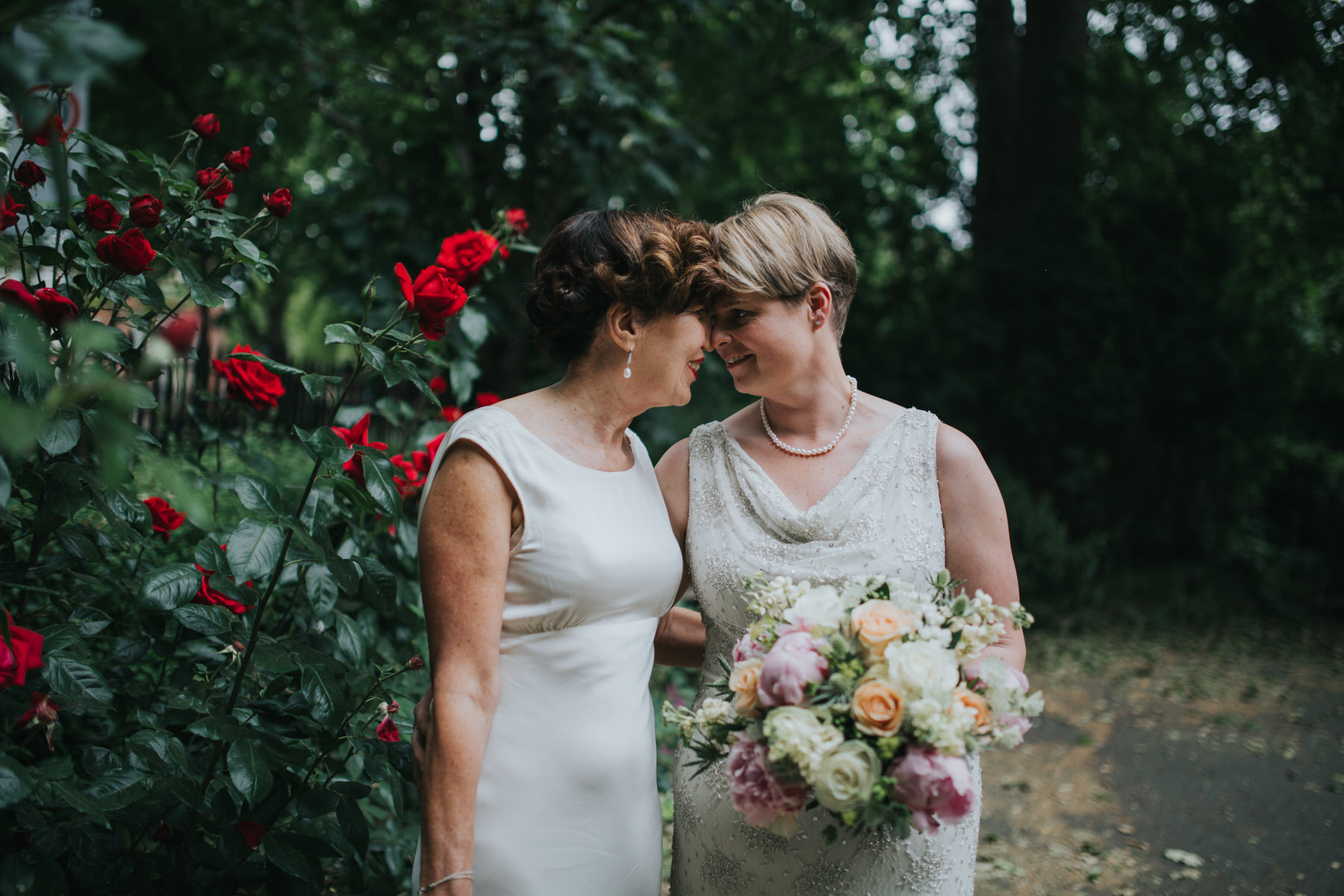 194 touching forehead two brides wedding portraits London reportage.jpg