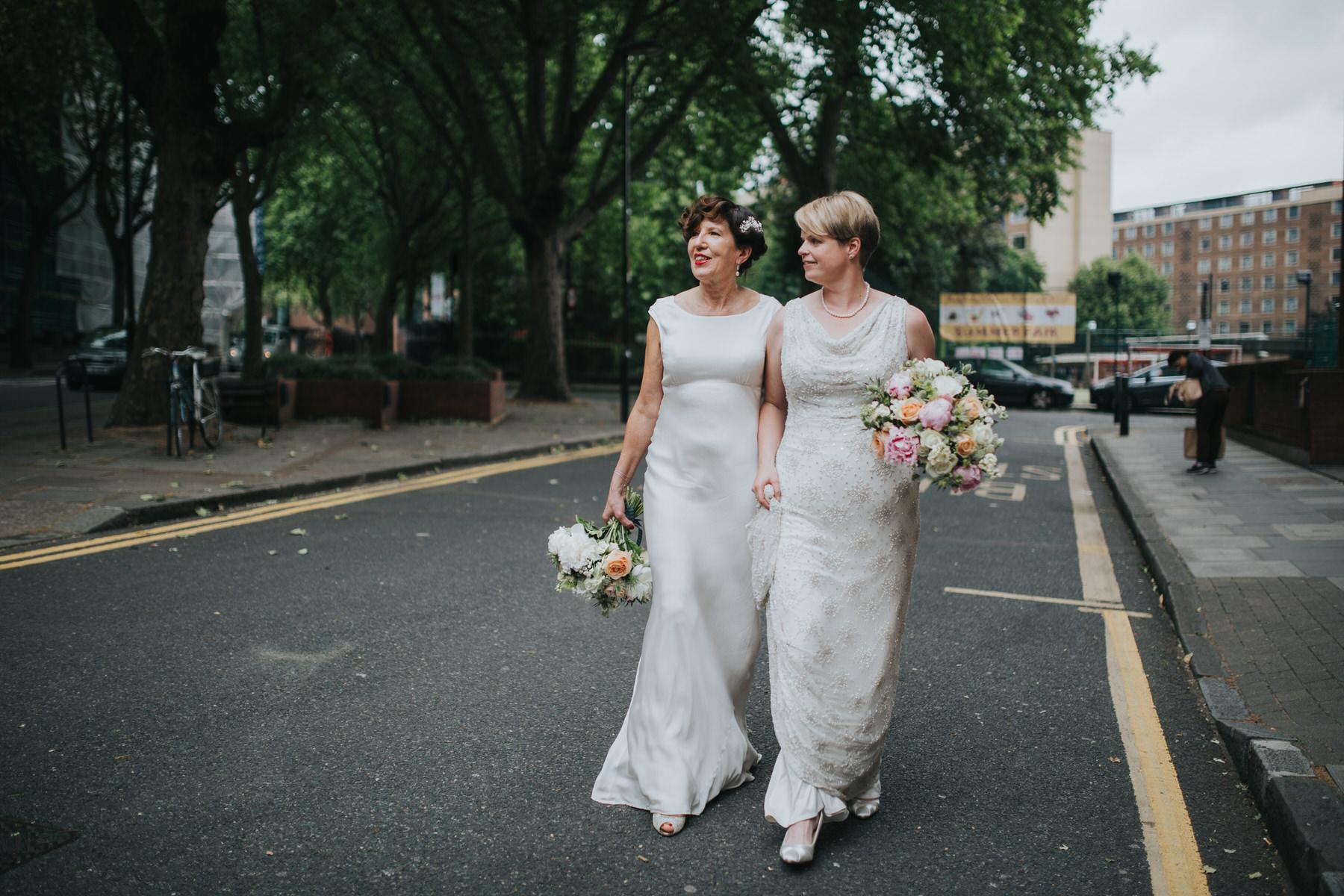 202 two brides couple walking blush  bouquets.jpg