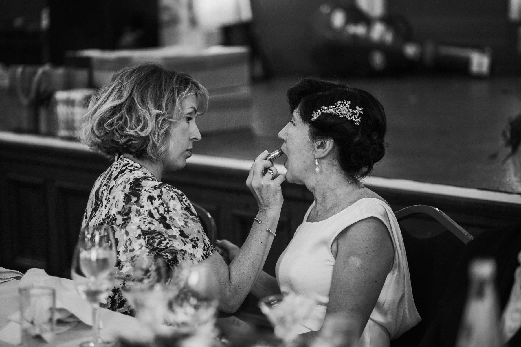 236 BW bride receiving makeup touch ups wedding.jpg