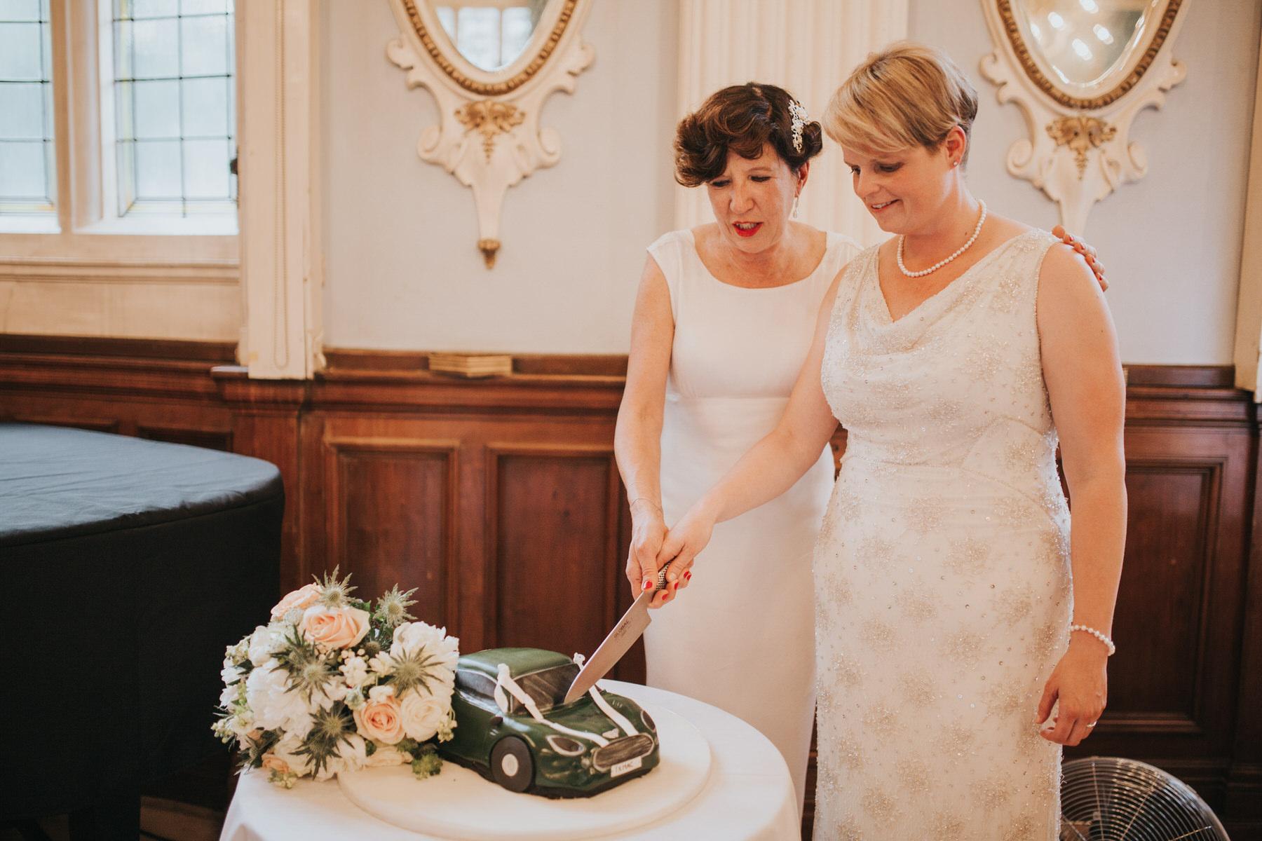 247 two brides cutting unusual green sports car cake.jpg