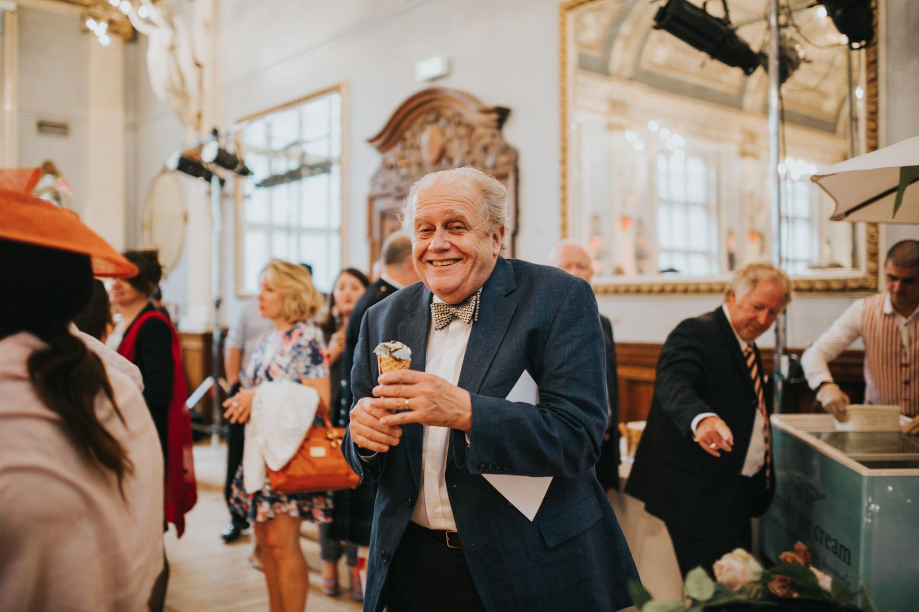 256 Old Finsbury Town Hall wedding guest eating icecream.jpg