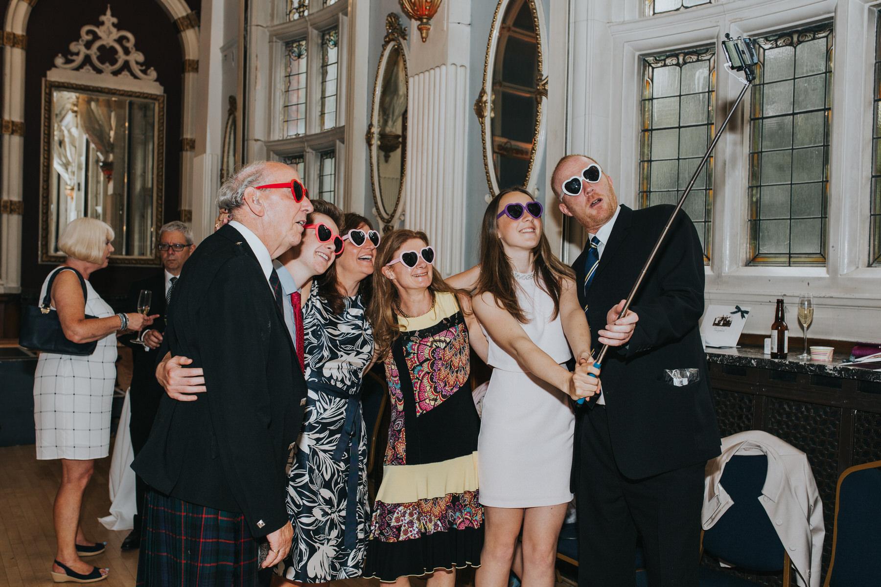 262 Islington wedding guests selfie stick.jpg