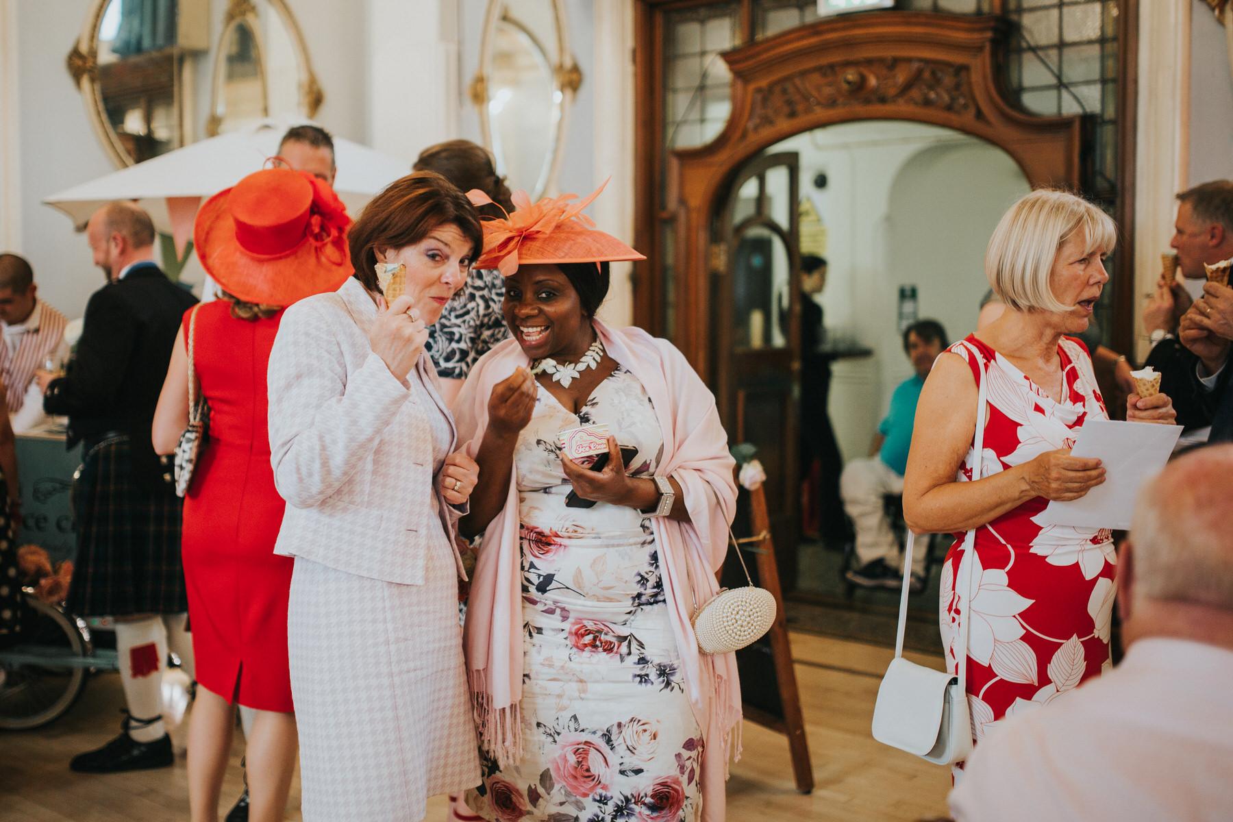 260 Old Finsbury Town Hall wedding guests eating icecream.jpg