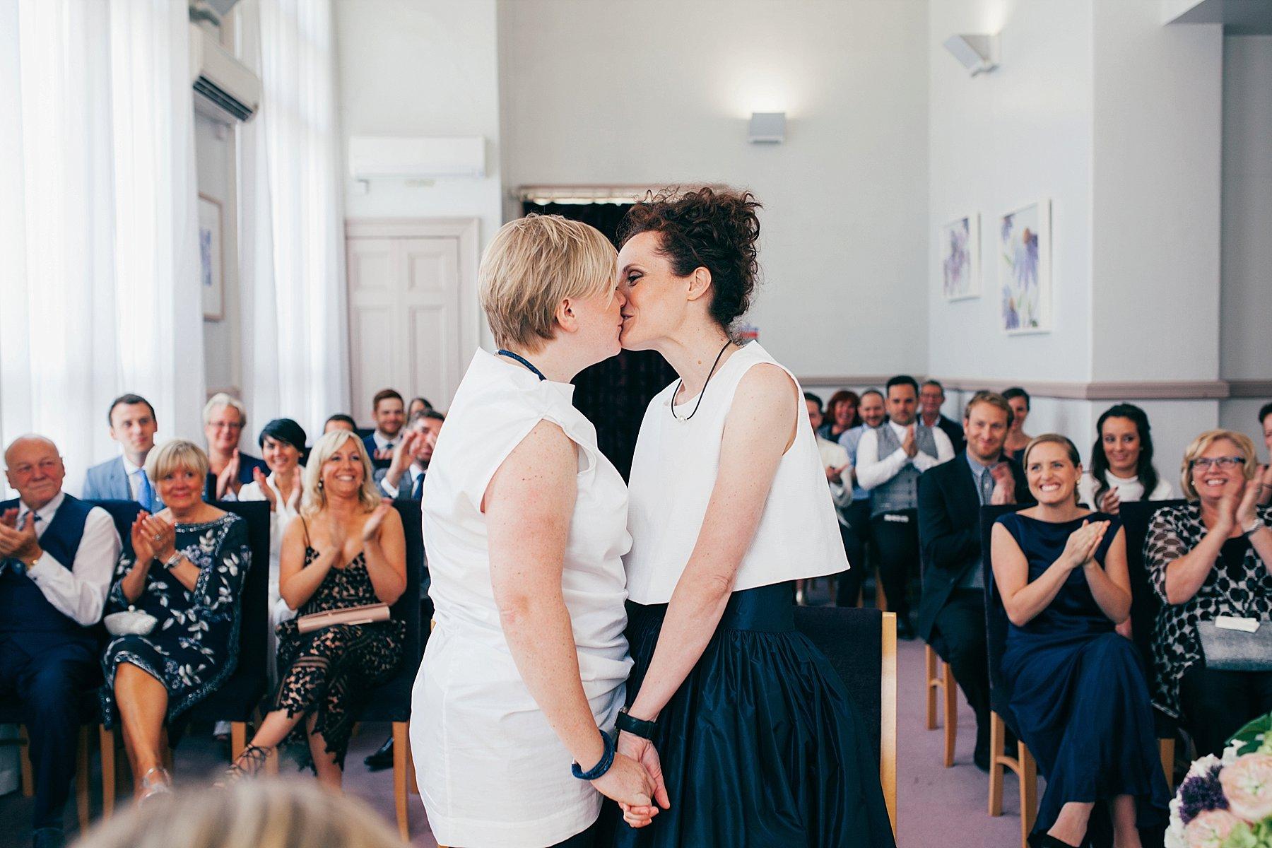 CV-233 two brides kiss Leeds documentary wedding photographer.jpg