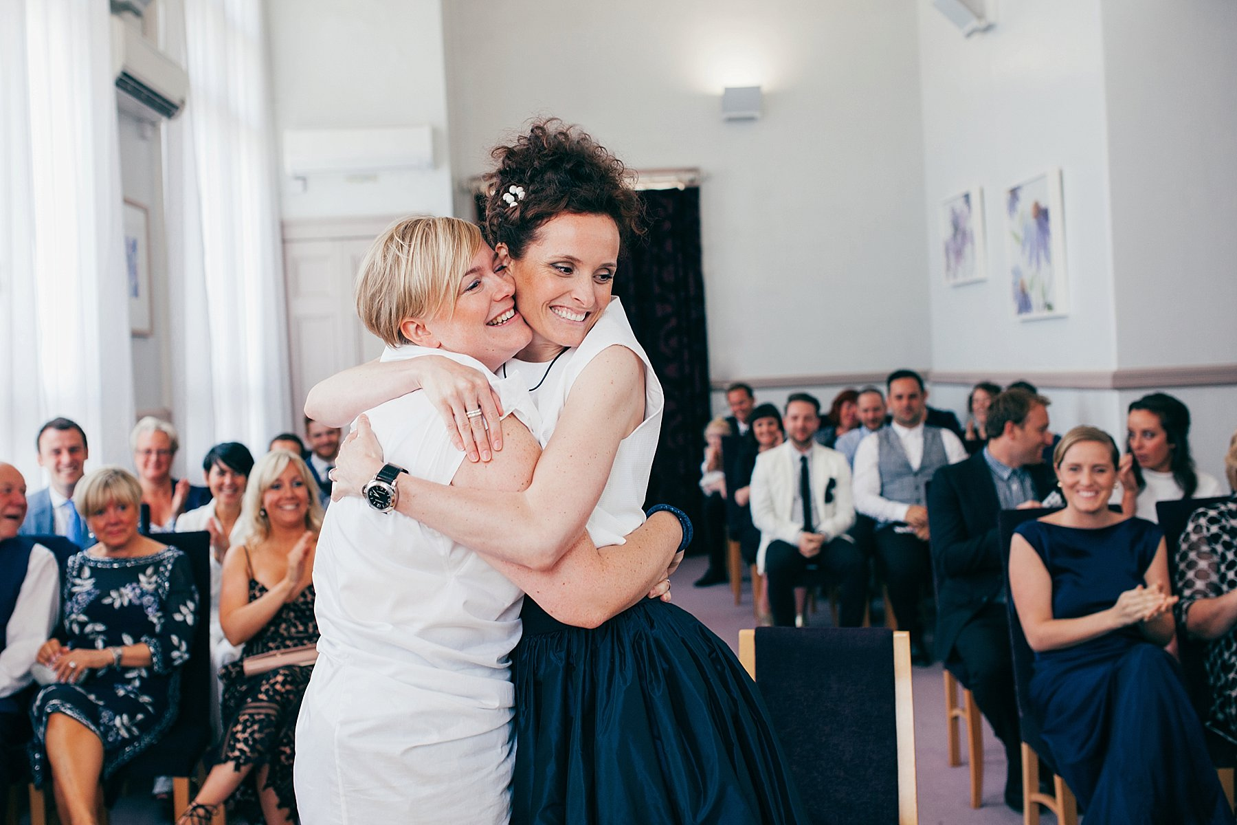 CV-237 two brides embrace Leeds wedding photographer.jpg
