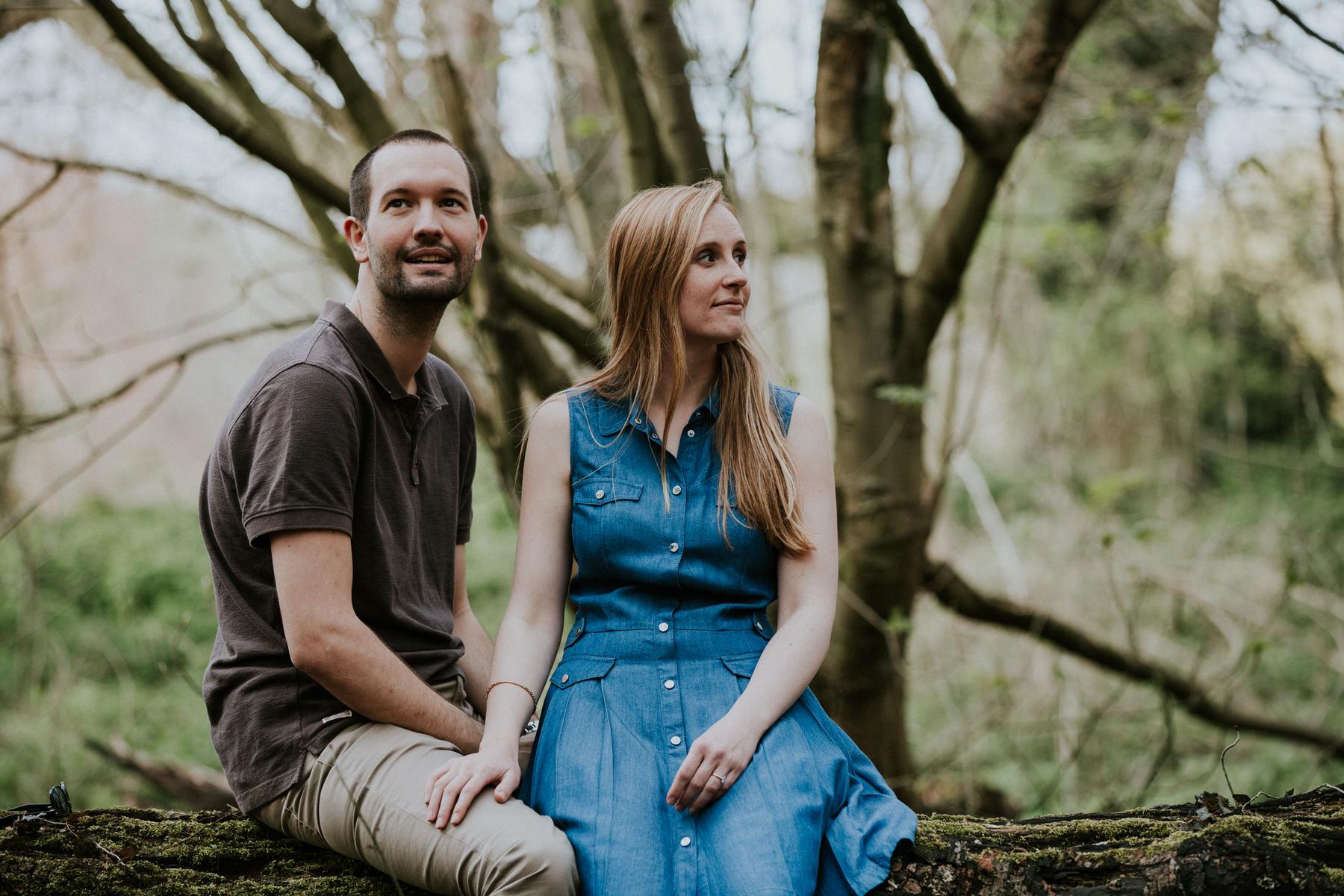 25-couple sitting on log forest pre-wedding photo London.jpg