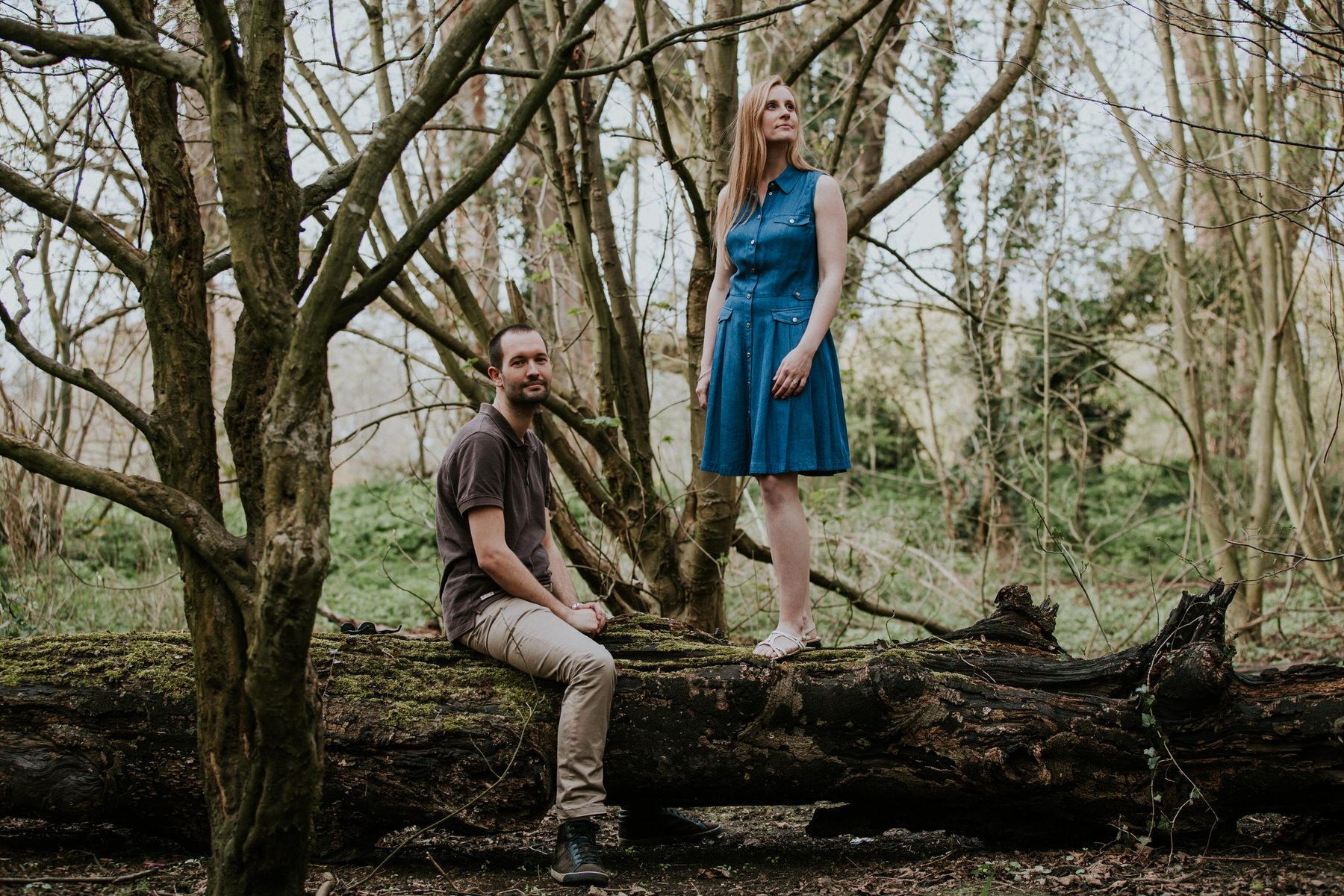 27-couple standing on log forest pre-wedding photo London.jpg