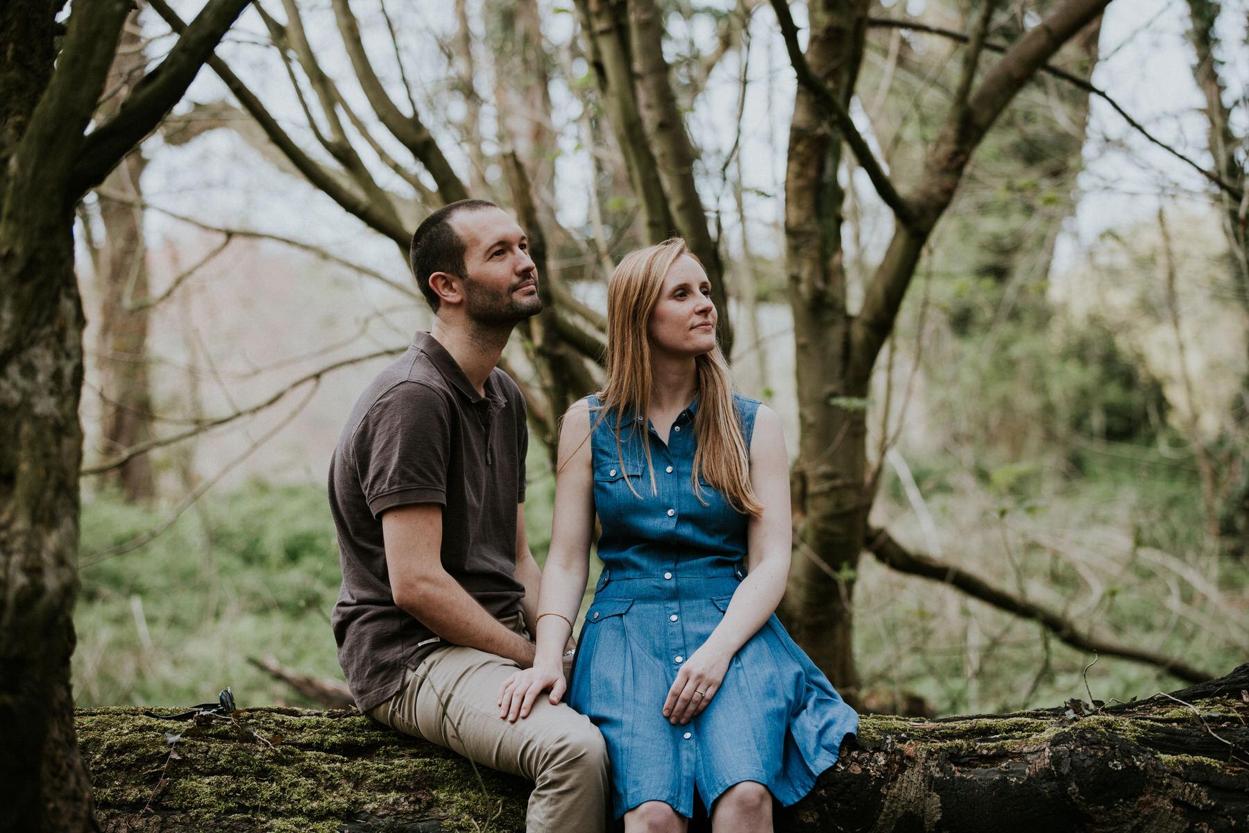 26-couple sitting on log forest pre-wedding photo London.jpg