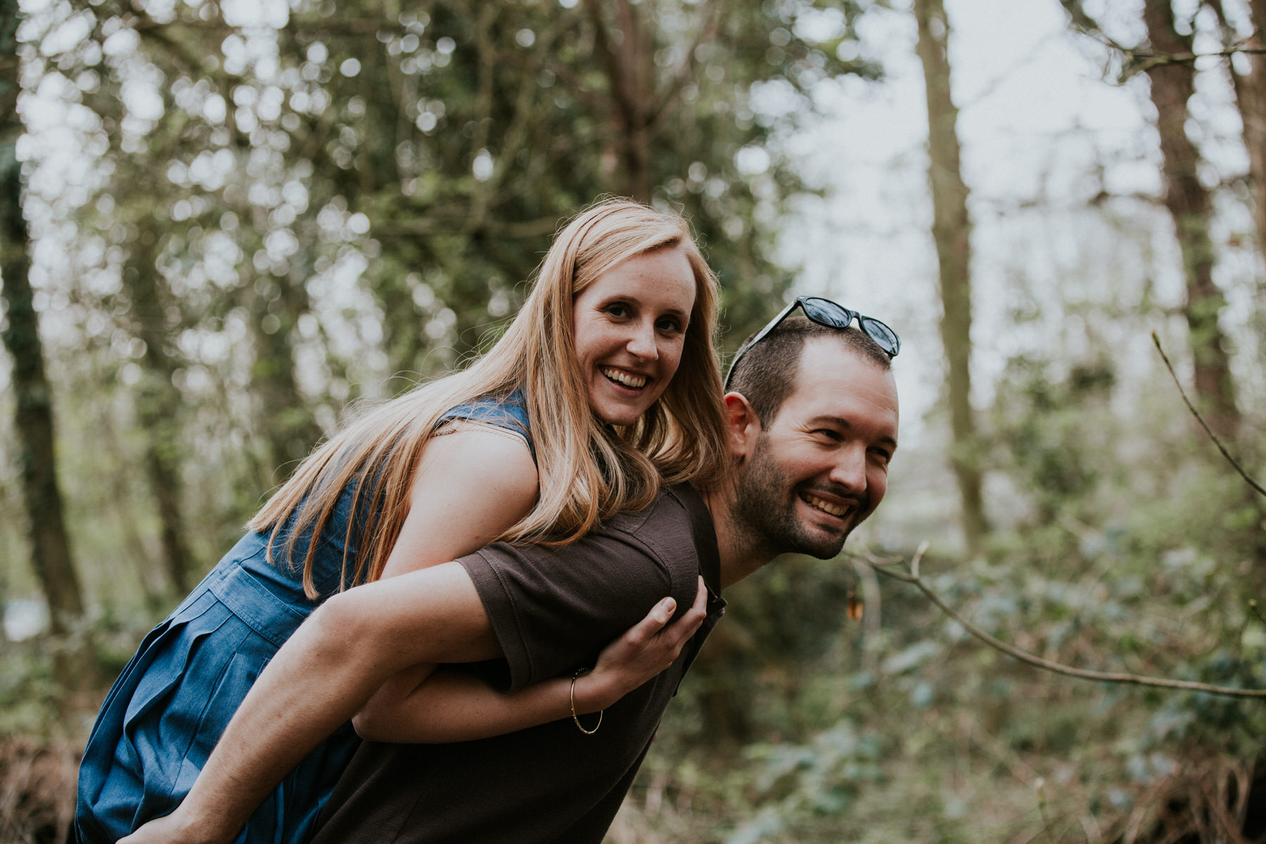 29-couple piggy back playing during couple portraits Richmond.jpg