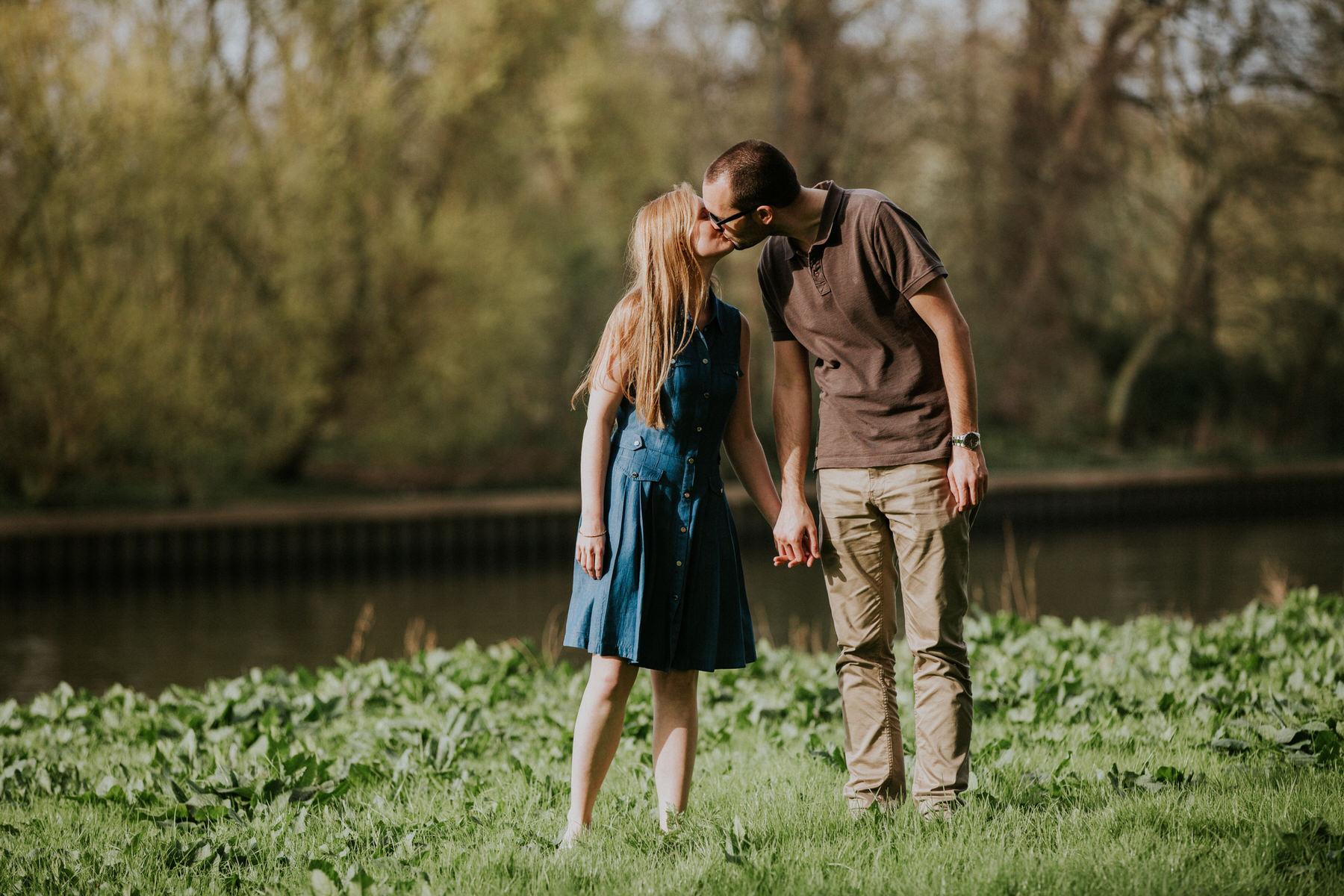 38-kissing couple summer engagement portrait Thames.jpg