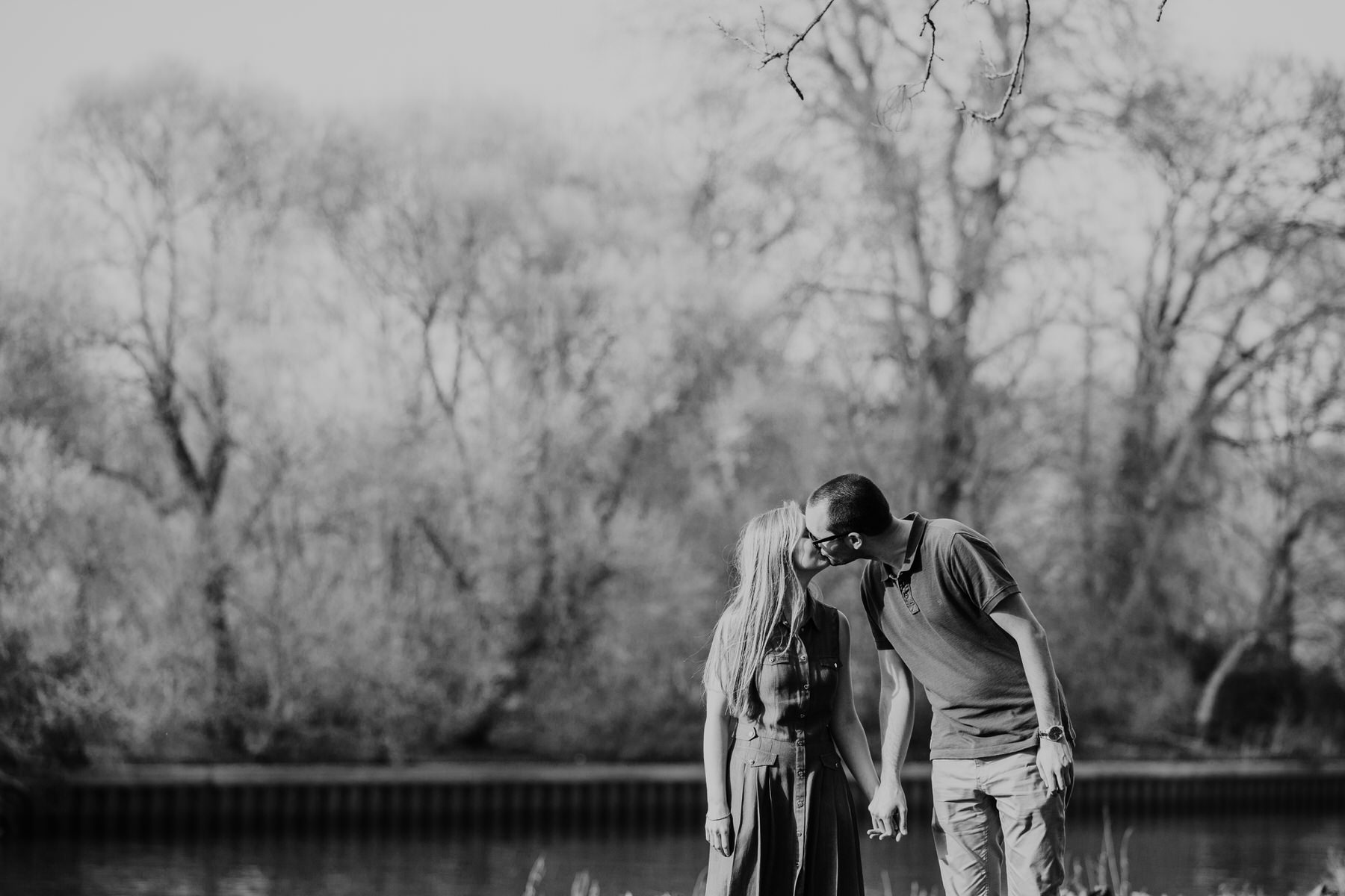 39-kissing couple summer engagement portrait Thames.jpg
