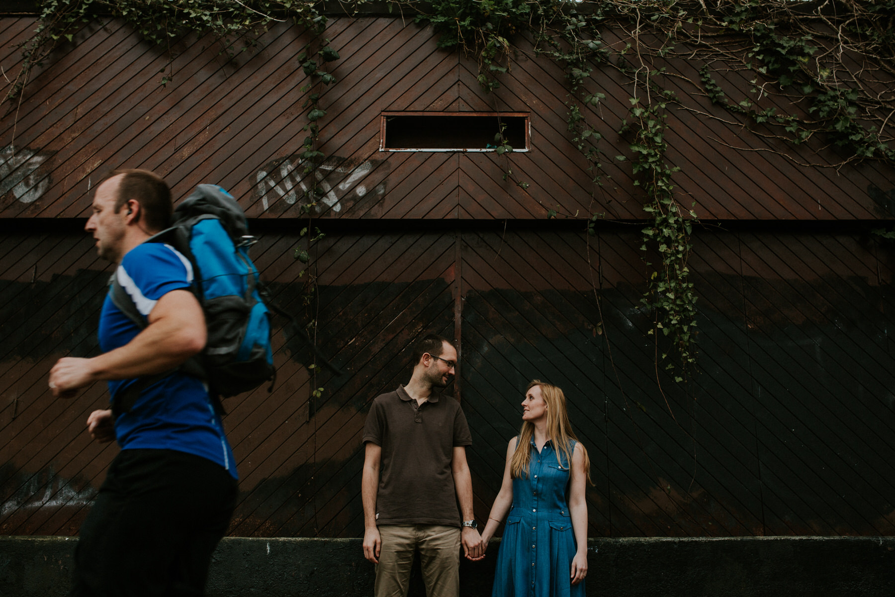 71 runner photobombing couple portrait shoot.jpg