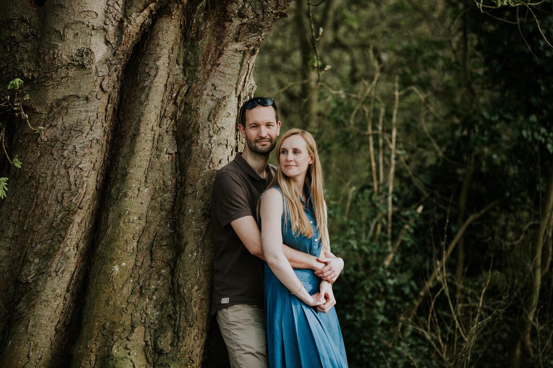 18-couple leaning into tree engagement shoot.jpg