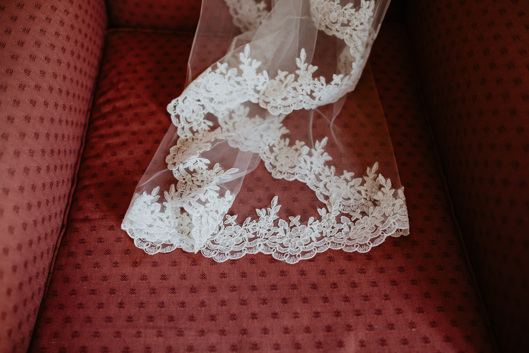 26 brides veil on red chair Yolande De Vries Photography.jpg