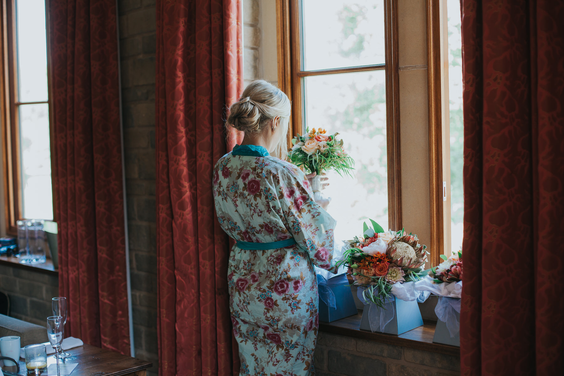 42 bride admiring bouquets reportage wedding photo.jpg
