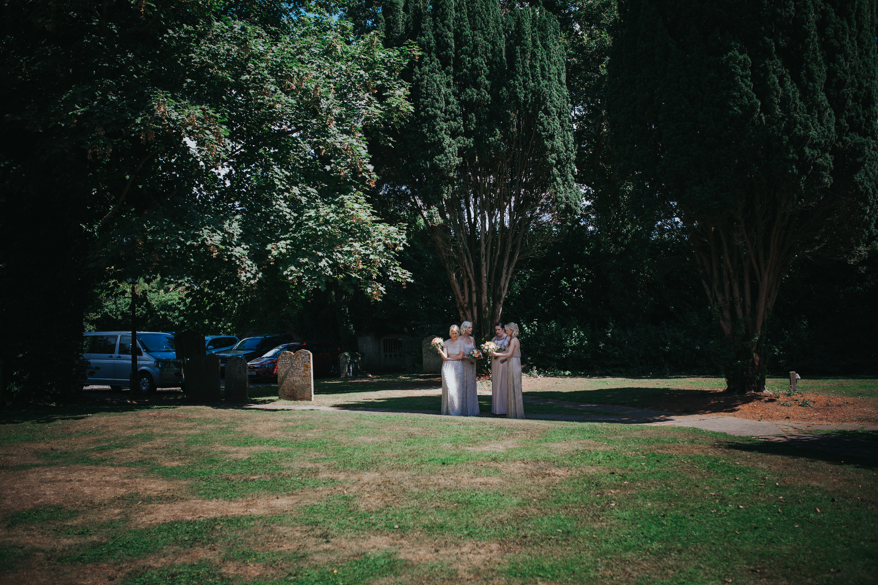 88 bridesmaids waiting bride in churchyard.jpg
