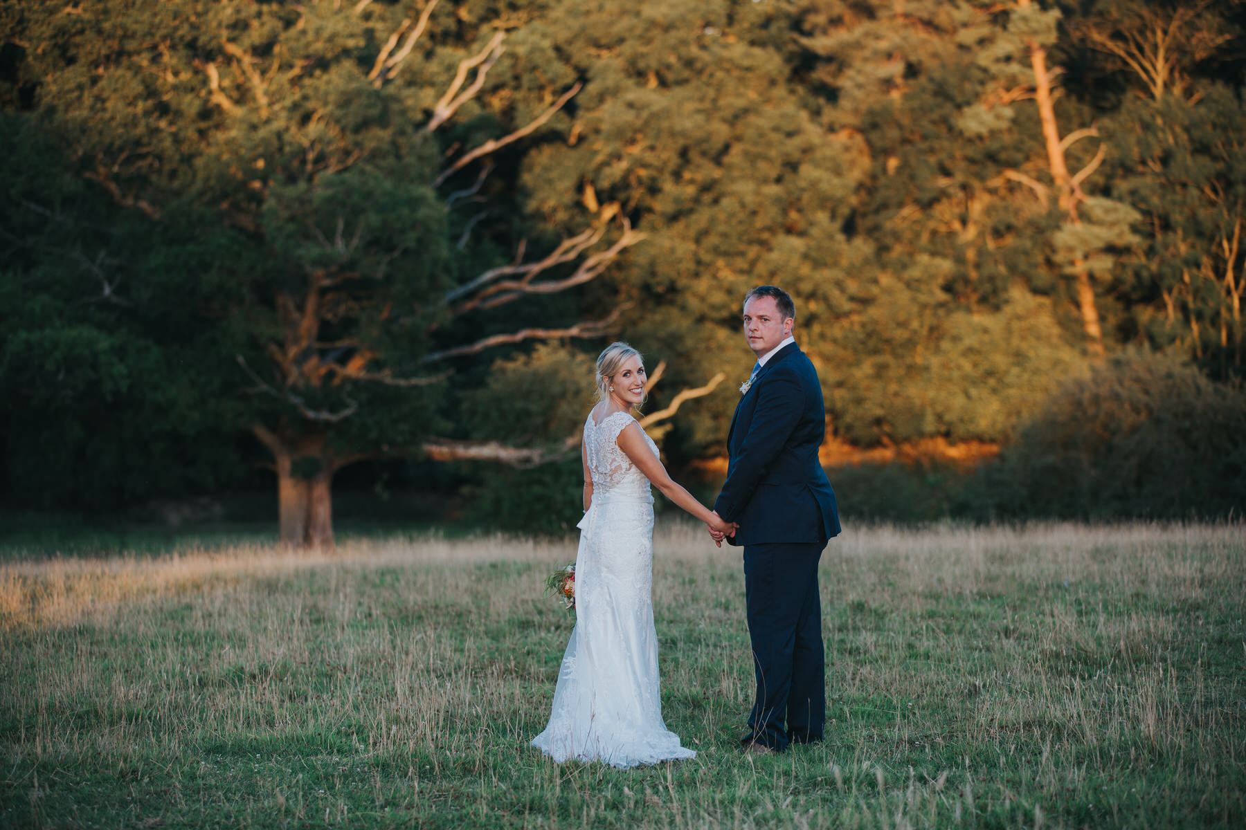 298 Knepp Castle golden hour wedding portraits bride wearing maggie sottero.jpg