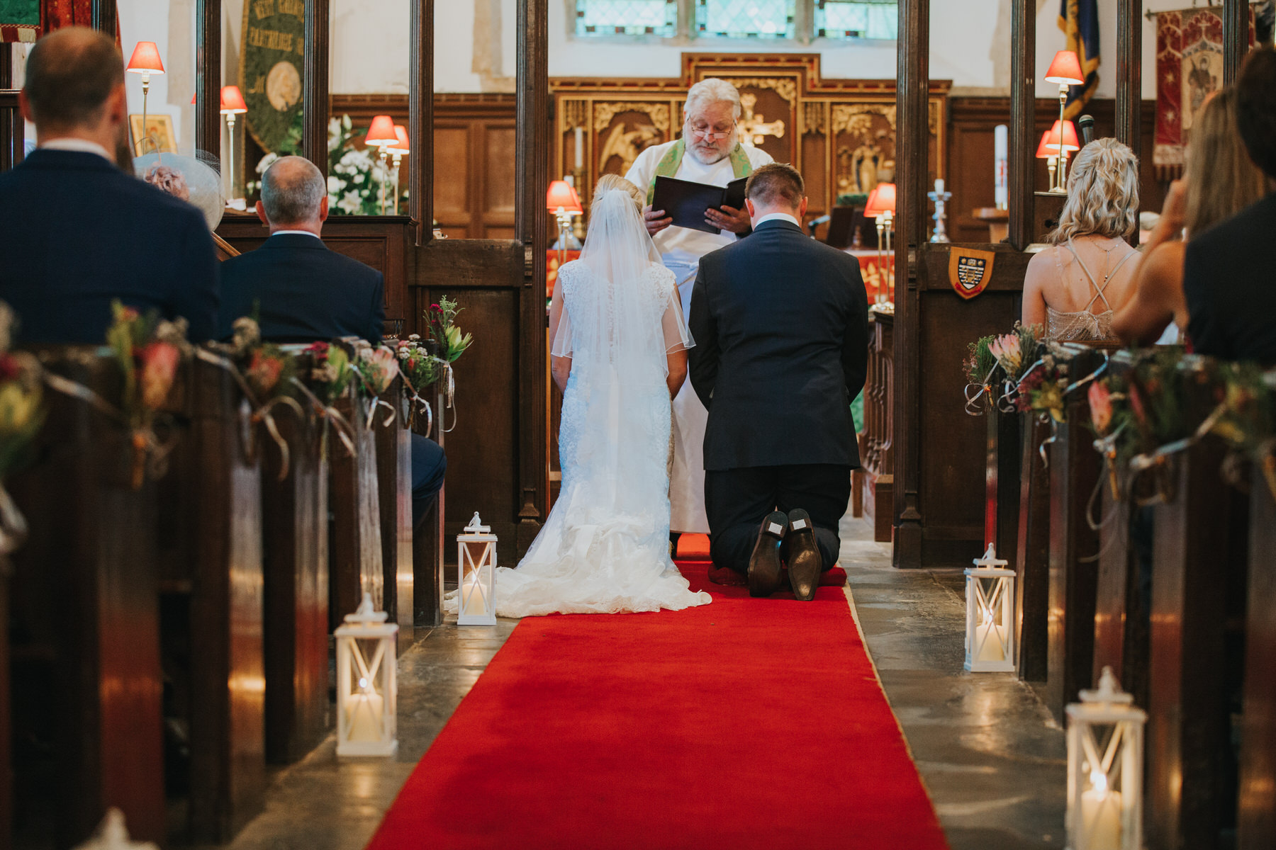 110  bride and groom receiving blessing church wedding ceremony .jpg
