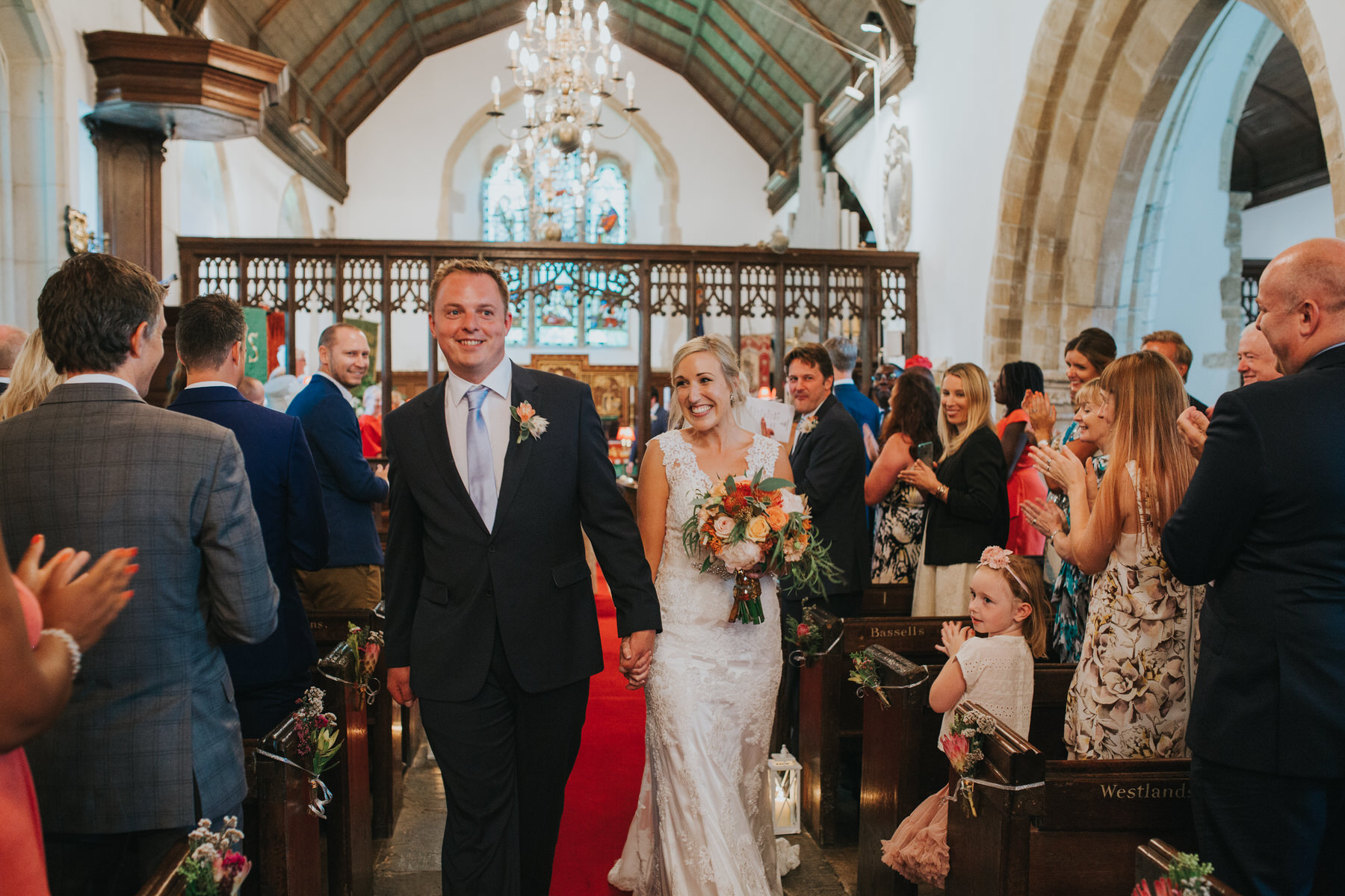 114 just married bride groom exit St Georges church West Grinstead.jpg