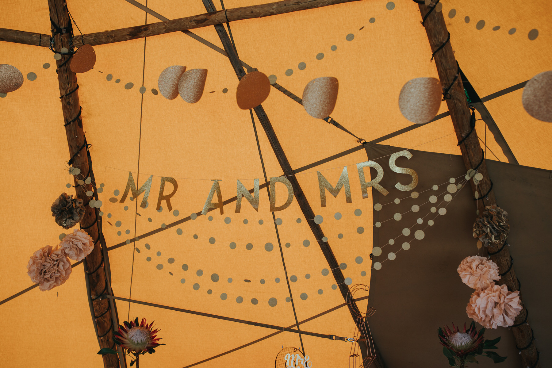 132 Mr and Mrs gold sign cake table tipi Knepp Castle.jpg