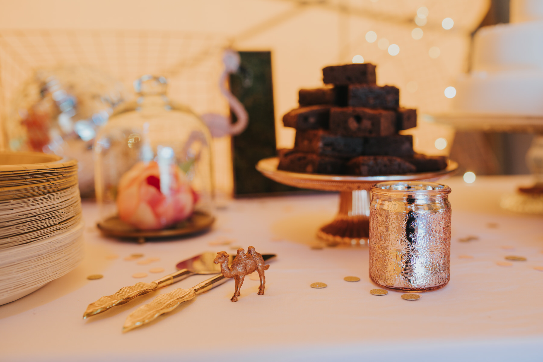 187 cake table Knepp Castle festival gold tipi sequins camel wedding.jpg