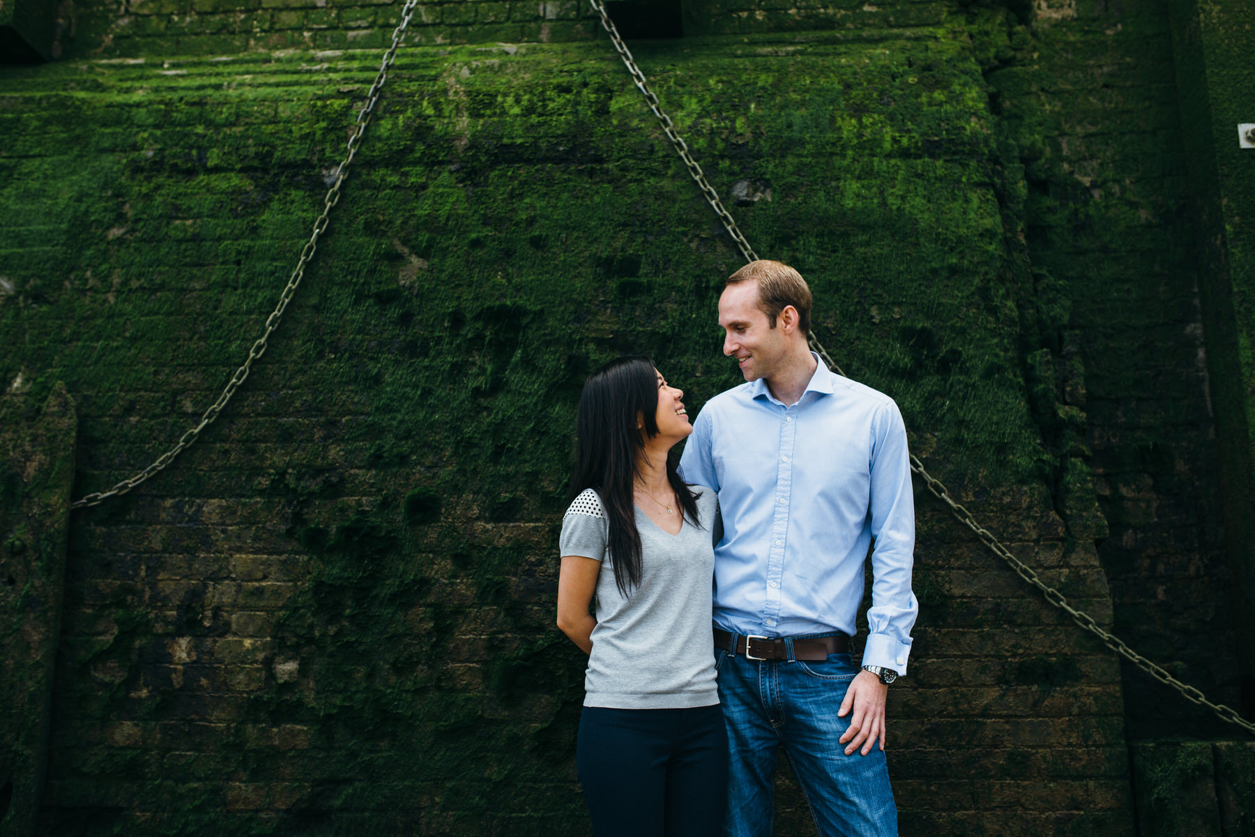 11 romantic portrait against green Thames beach wall.jpg