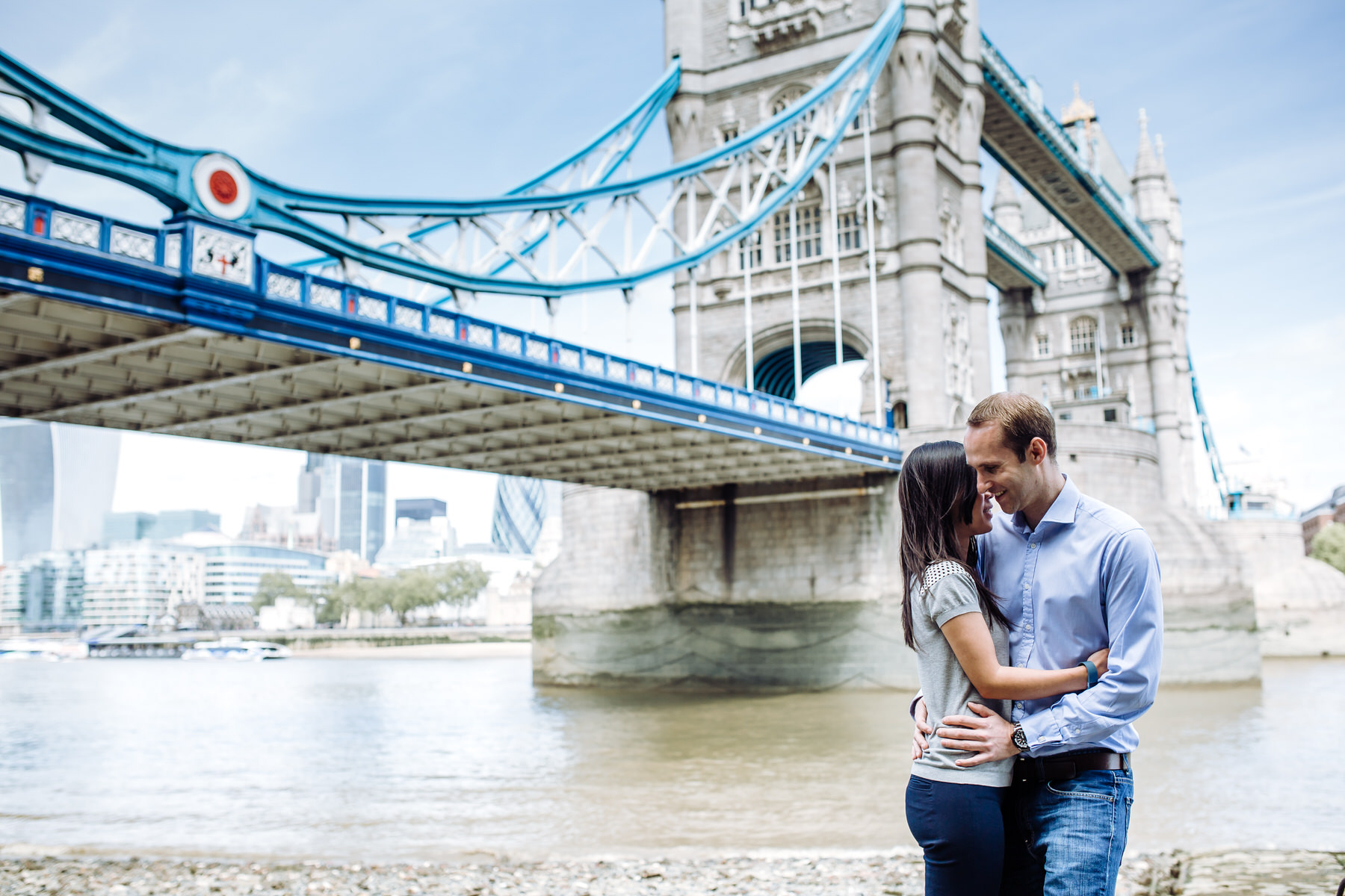 8 engaged couple standing under Tower Bridge.jpg