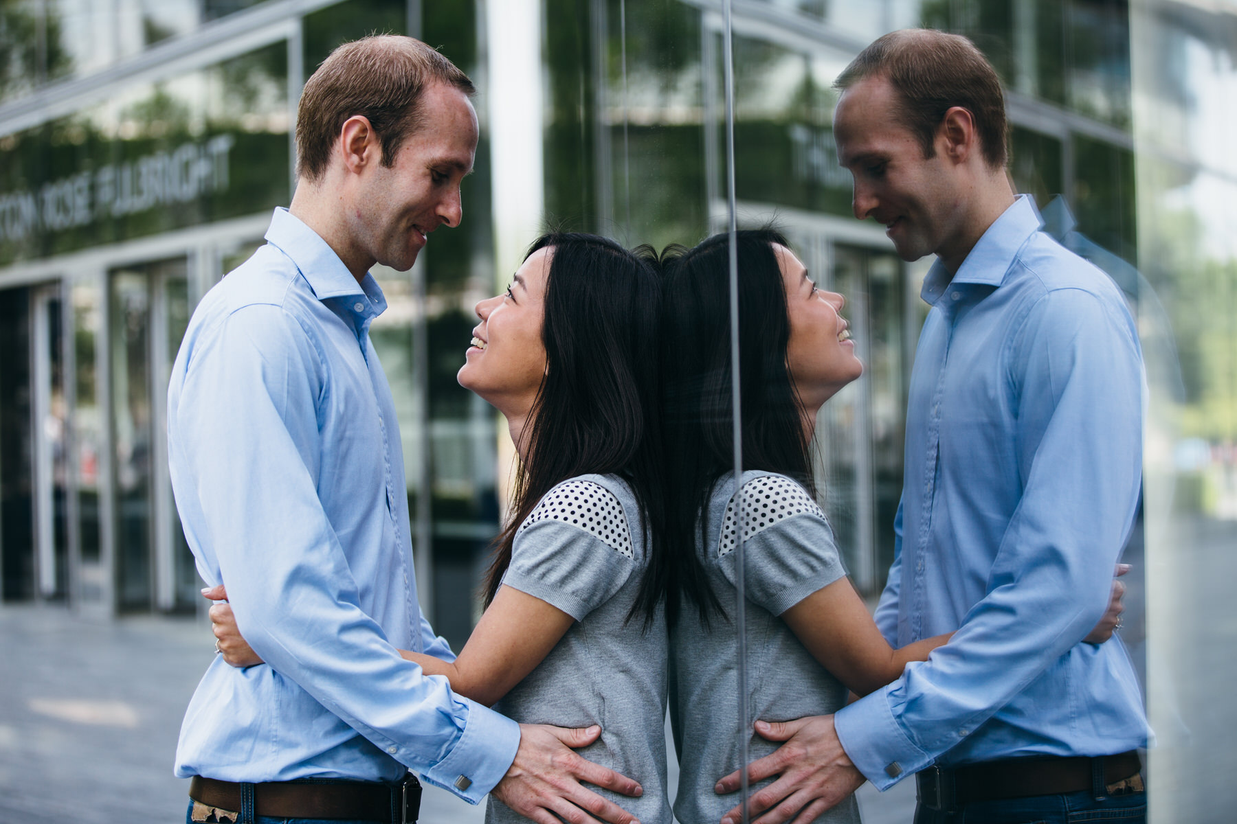 41 intimate moment engagement shoot glass reflection.jpg
