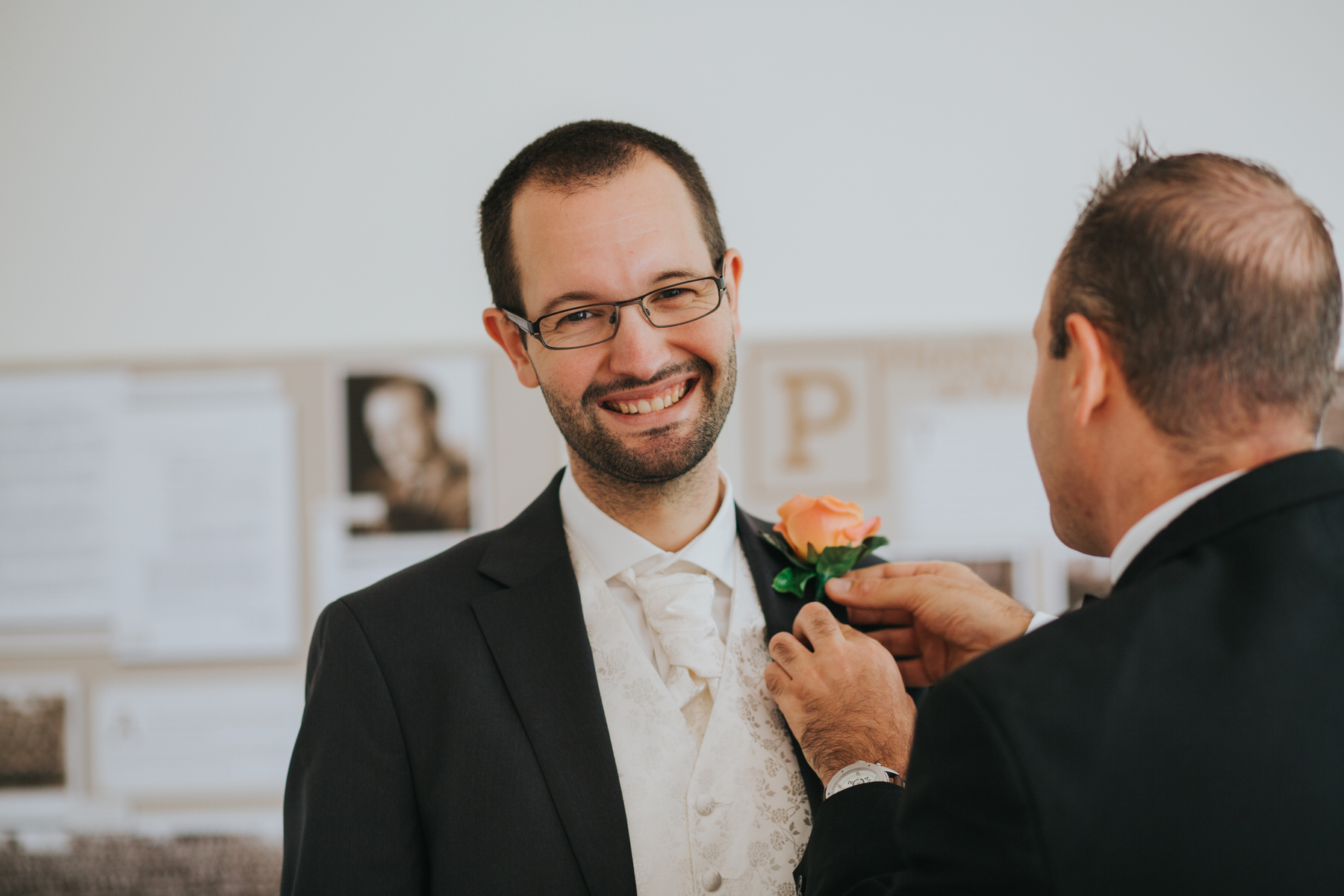 8 groom receiving orange rose buttoneire embroke Lodge.jpg