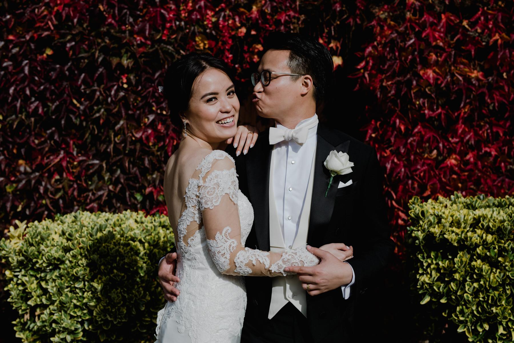 Quirky bride groom red ivy wedding portrait.jpg