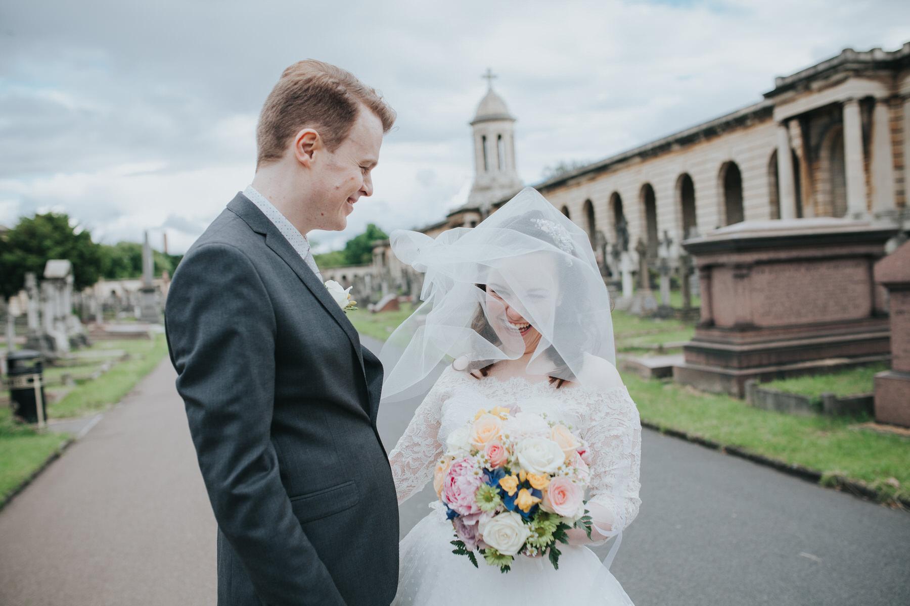 groom bride windy veil wedding portraits Brompton Cemetery.jpg