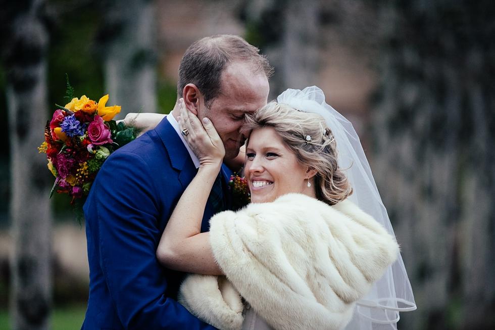 Knebworth bride embracing groom winter wedding.jpg