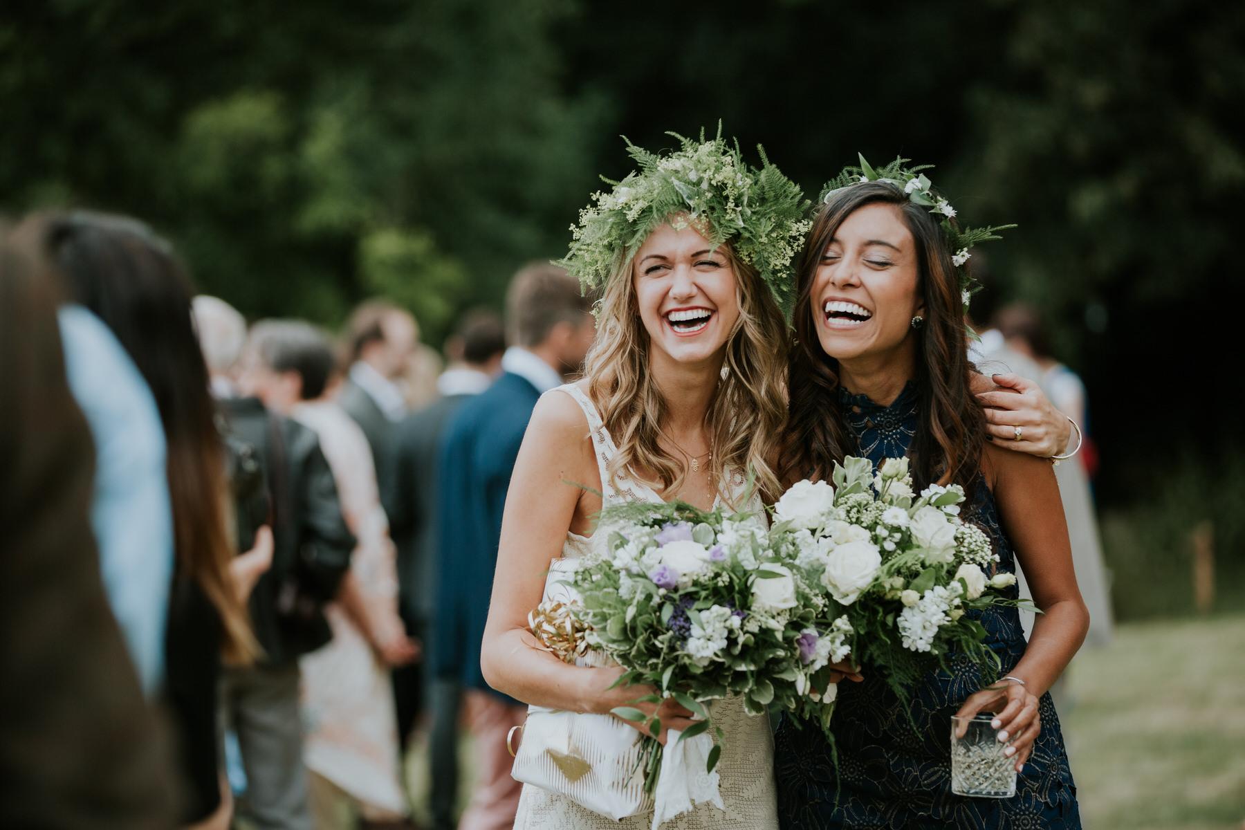 intimate moment bride bridesmaid fern crowns reportage.jpg