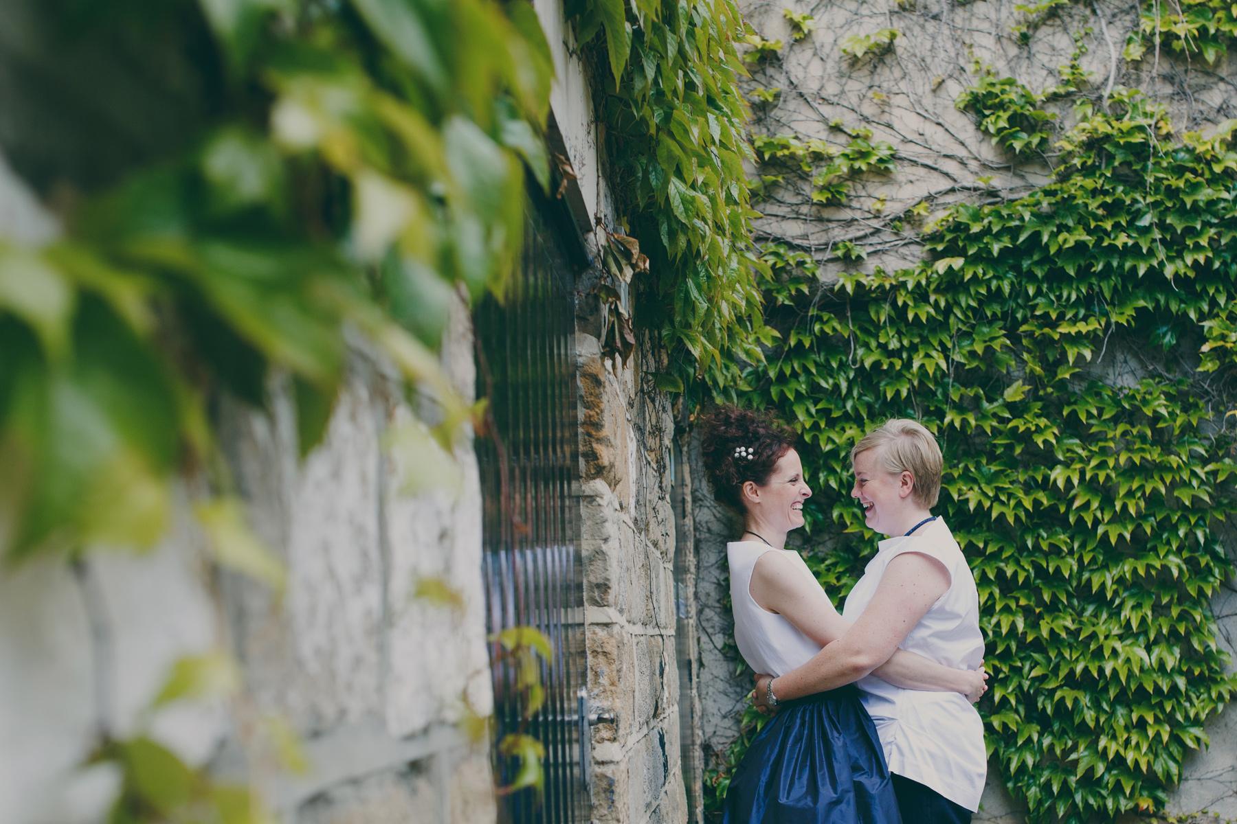 two brides embracing ivy walls Leeds wedding photographer.jpg