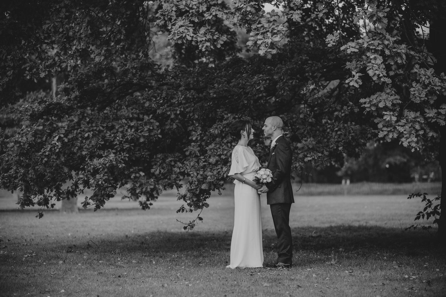 167 BW Belair Park bridal photo under tree.jpg