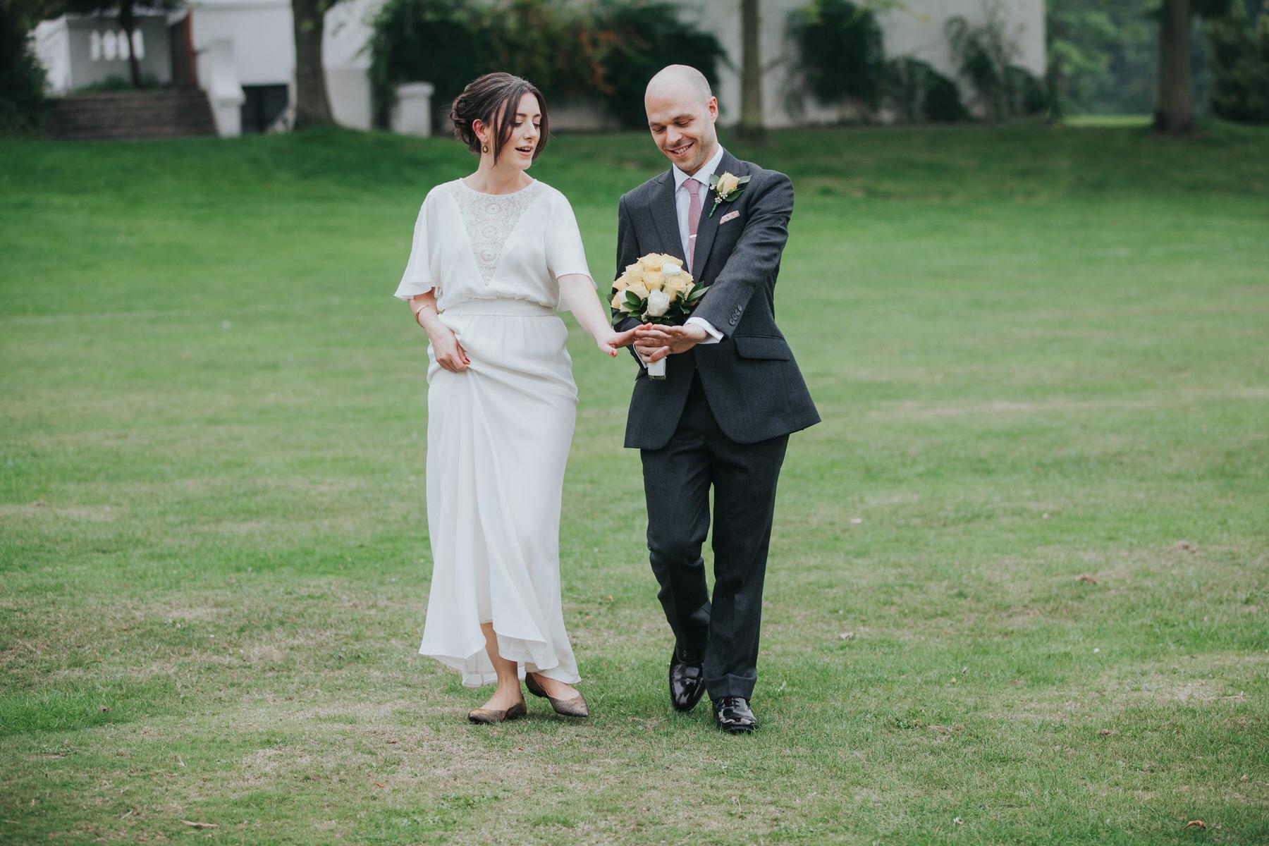 admiring rings bride groom documentary reportage belair House.jpg