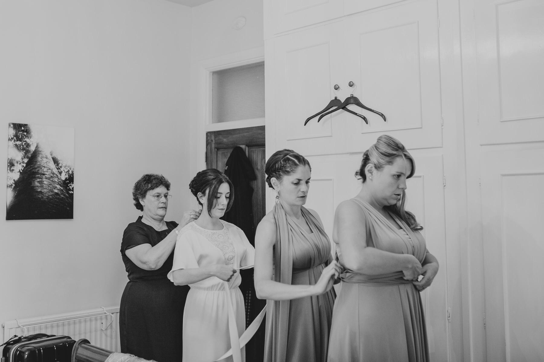 bridesmaids getting ready Minna wedding dress.jpg