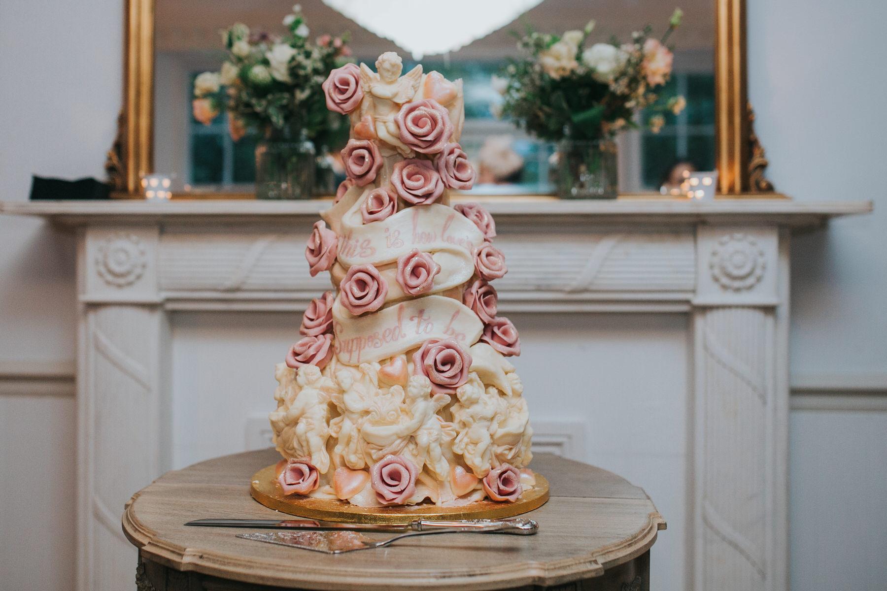 Choccywoccydoodah wedding cake pink roses cream cherubs.jpg