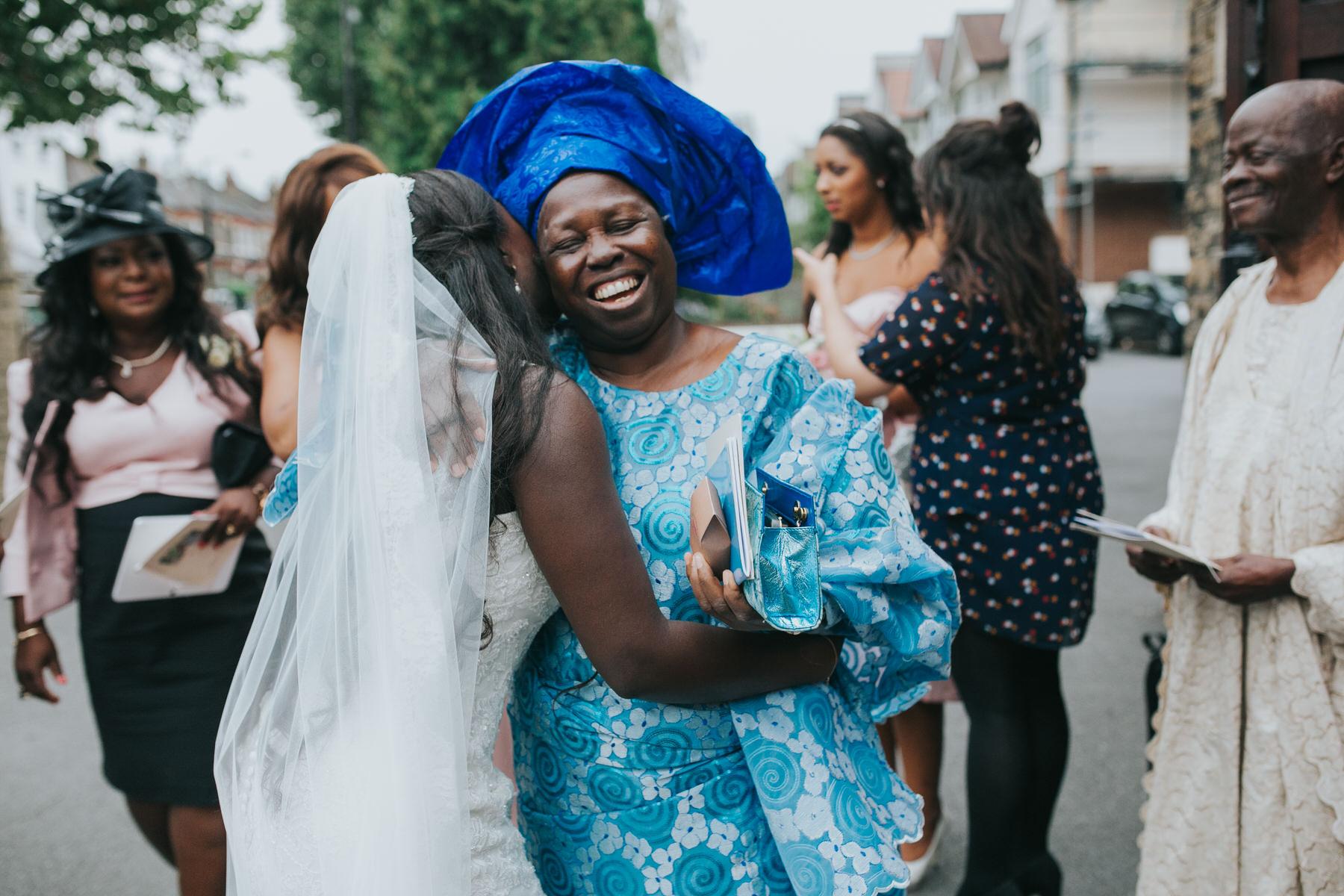 documentary style wedding photography emotional bride hugging aunt.jpg