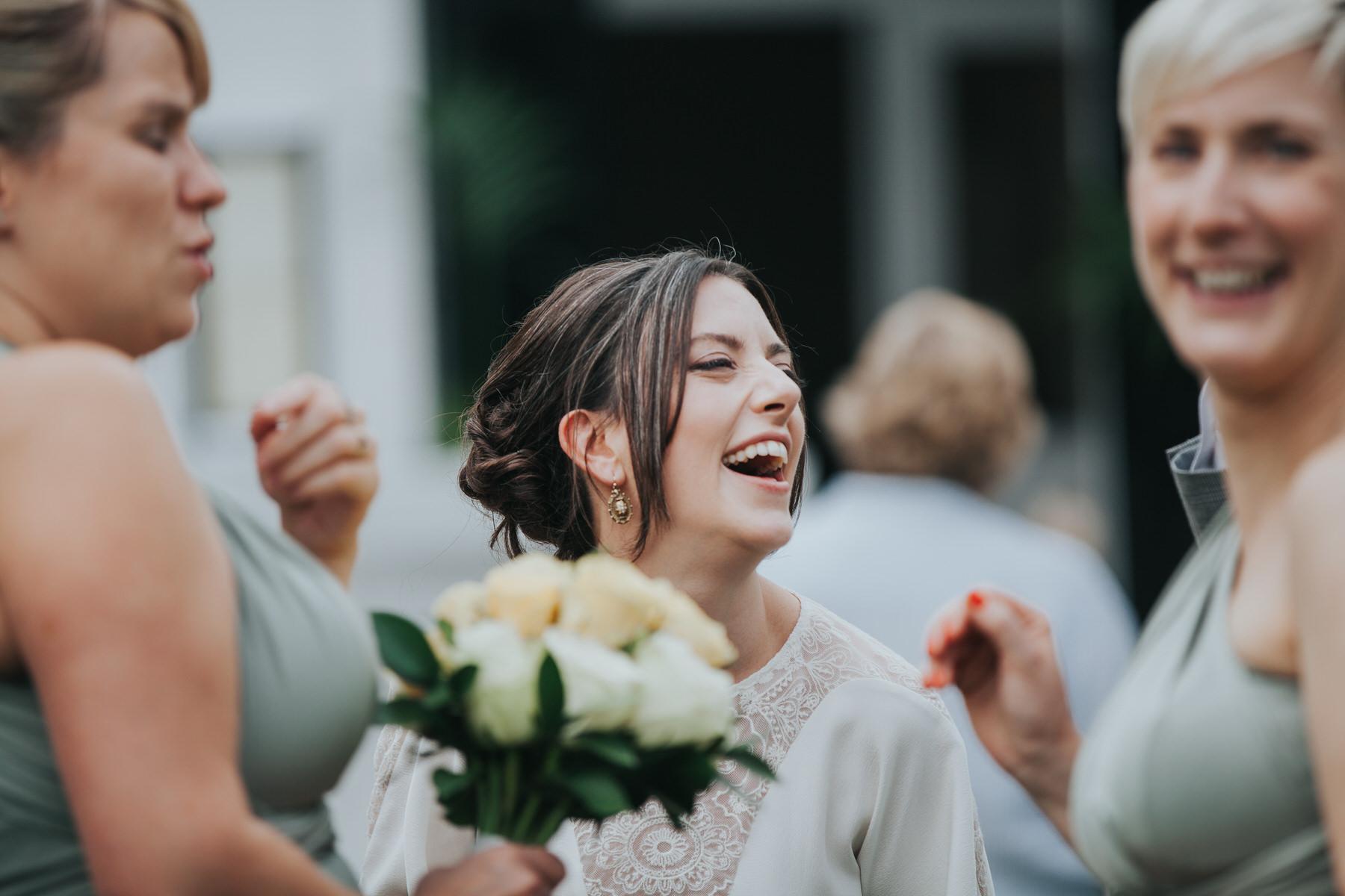 ecstatic bride London documentary wedding photographer.jpg
