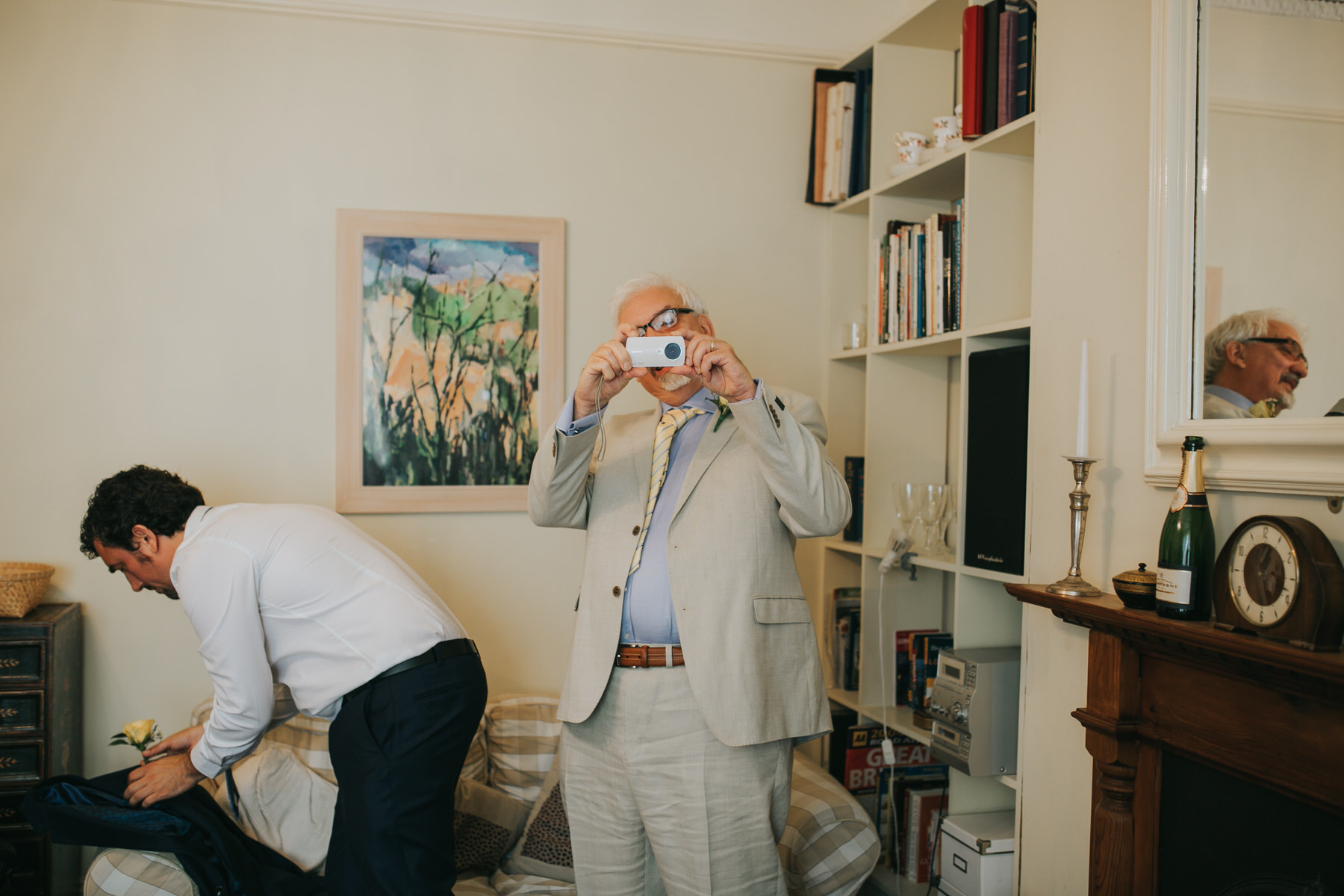 father of bride taking photos.jpg