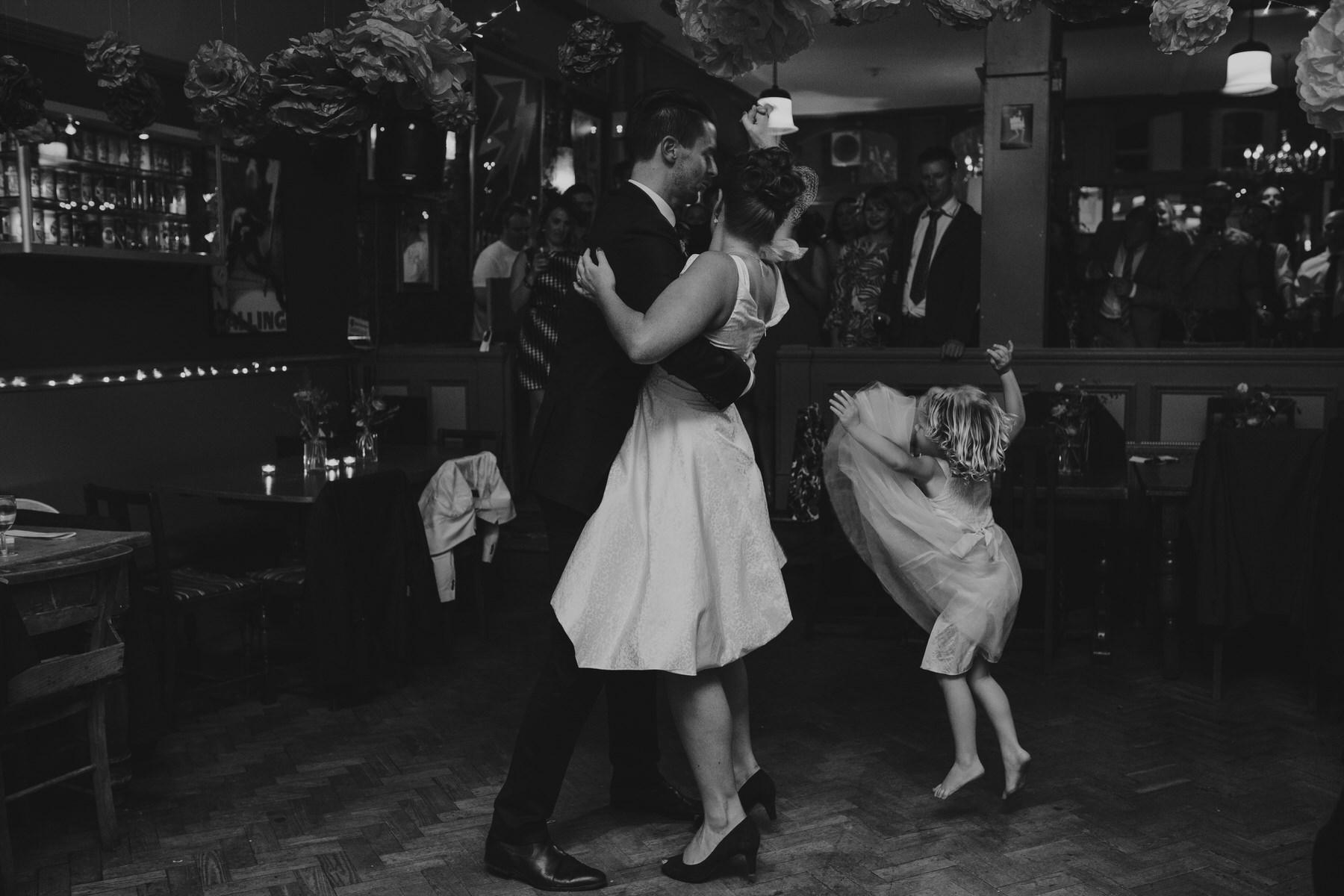 first dance Londesborough-Pub-wedding flowergirl photobomb.jpg