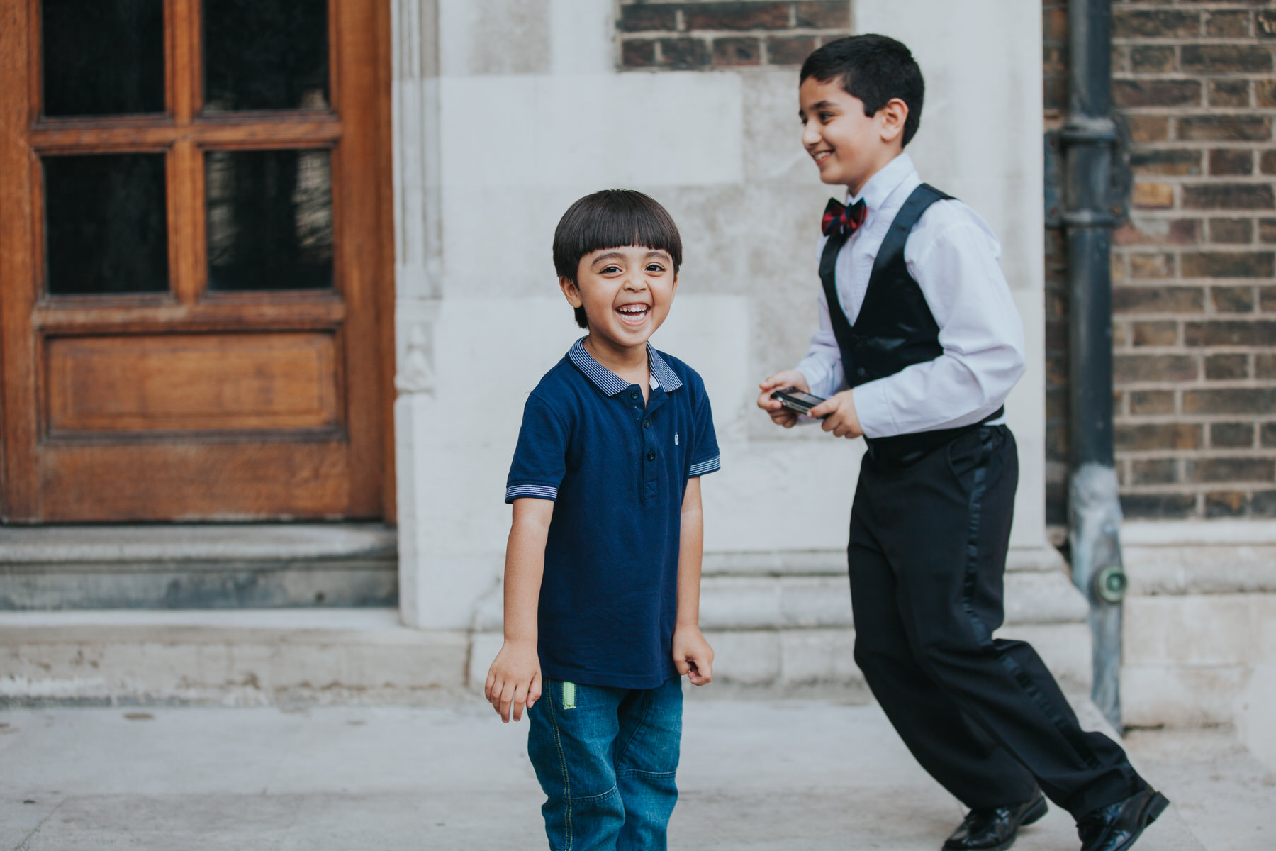 kids at Middle Temple wedding bouncing around.jpg