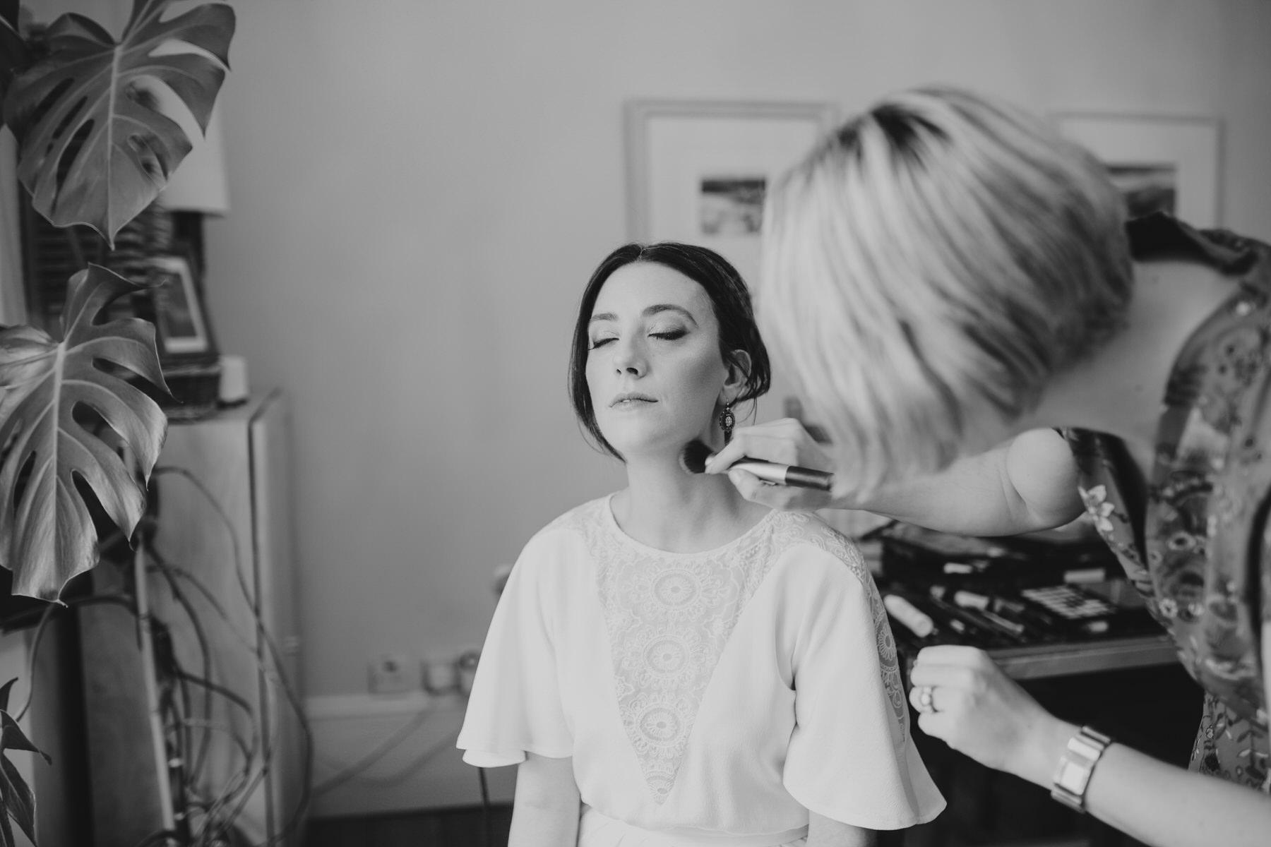 last makeup touch ups bride Minna wedding dress.jpg
