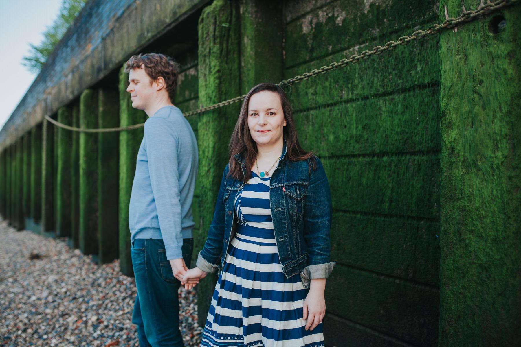 London couple holding hands engagement shoot.jpg