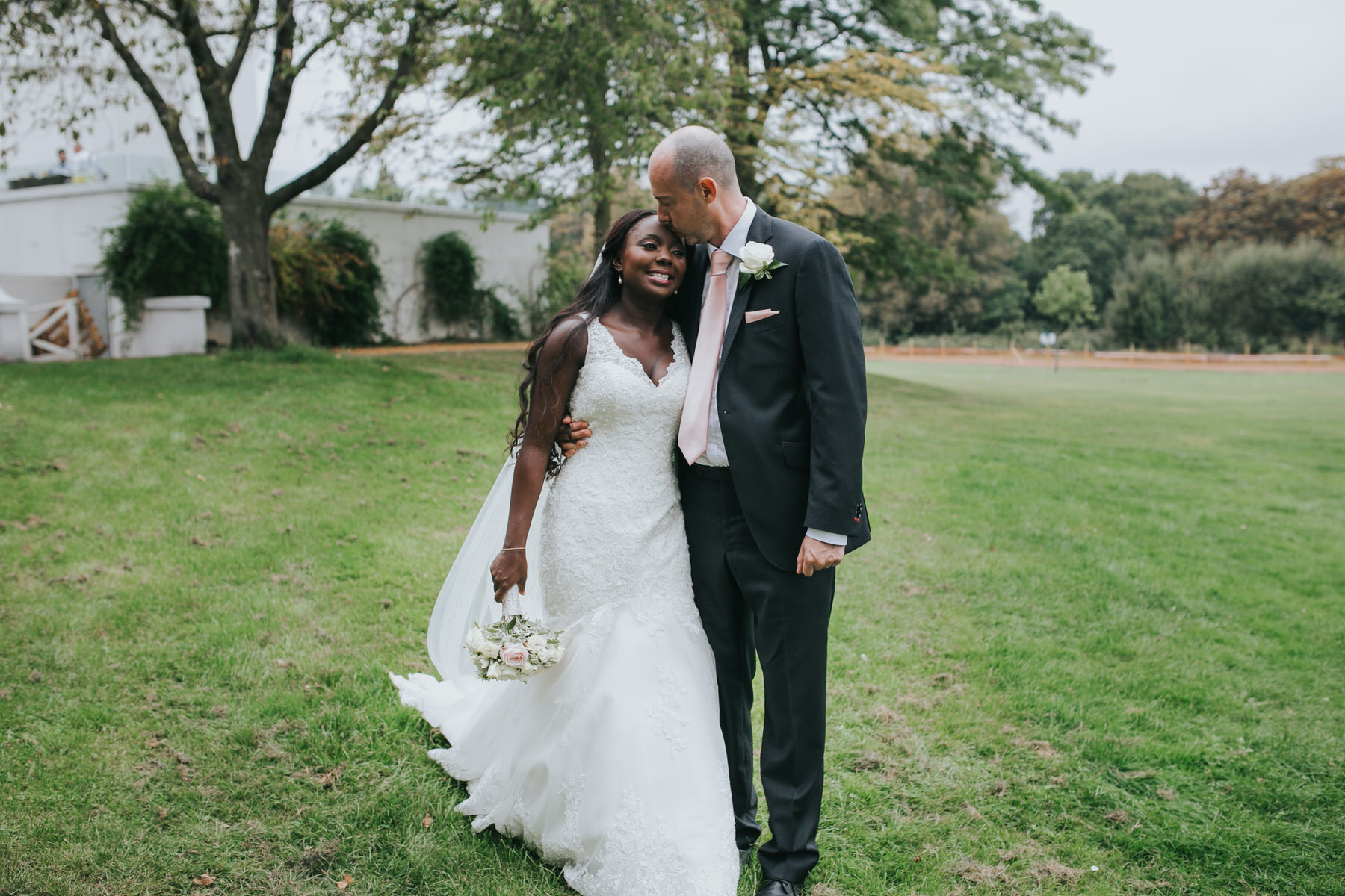 newly married couple intimate moment during wedding portraits .jpg