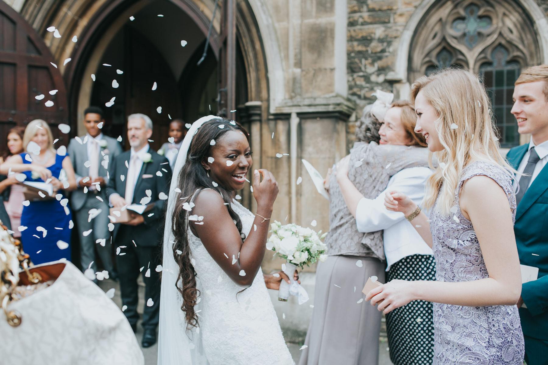 white confetti outside Church Dulwich wedding photographer.jpg